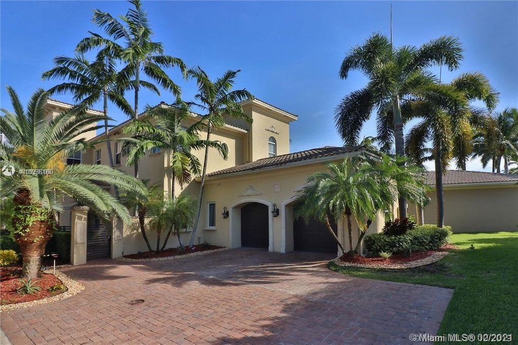 Private island with security. Freshly renovated, luxurious, modern, unique house located on the inter coastal with a dock, lift, vast open back yard, large pool plus jacuzzi, two car garage. This two story 6 bedroom 6 1/2 bathroom corner lot house located in Harbor Pointe. Fabulous Harbour Islands will definitely check off all your needs and wants anyone desires to have in a house! Newly painted entire inside, brand new flooring throughout all bedrooms, modern and exotic furniture, stainless steel appliances, crystal diamond chandeliers, LED lighting fixtures, full sized bar and seating area. Huge 1000 square feet master bedroom looking out at the inter-coastal waters. With his and hers closets and his and hers sinks. Close to 5500 square feet.