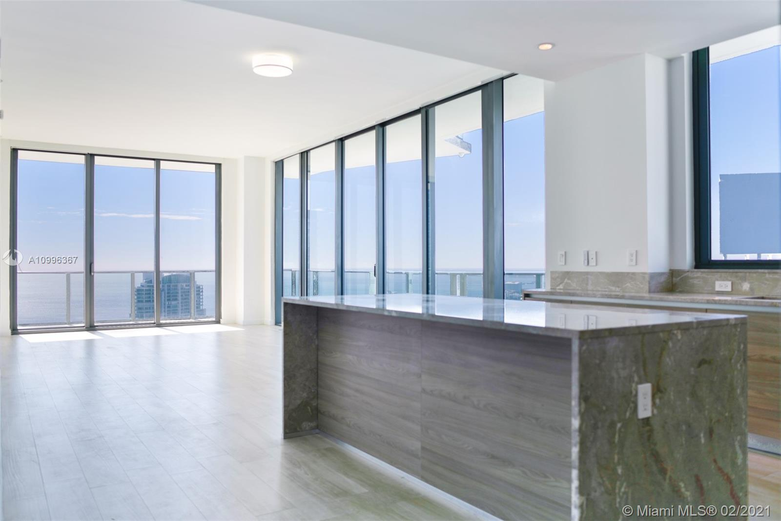 Spectacular upgraded penthouse unit at the luxury SLS Brickell. Relax in this open floor concept while enjoying the panoramic views of Miami Bay and Ocean during the day, Brickell skyline at night, & all the comfort of a 5-star hotel. Very bright corner unit with 4 beds, 3.5 baths, floor-to-ceiling glass windows, sleek wood like porcelain tile floors, california closets, custom made electric window treatments, glistening Italian marble kitchen, Bosch & Miele appliances, 2 assigned parking spaces & a huge wraparound balcony! Amenities include sky roof pool, movie theater, private party room, restaurants, bar, gym, full service spa, valet parking & concierge.