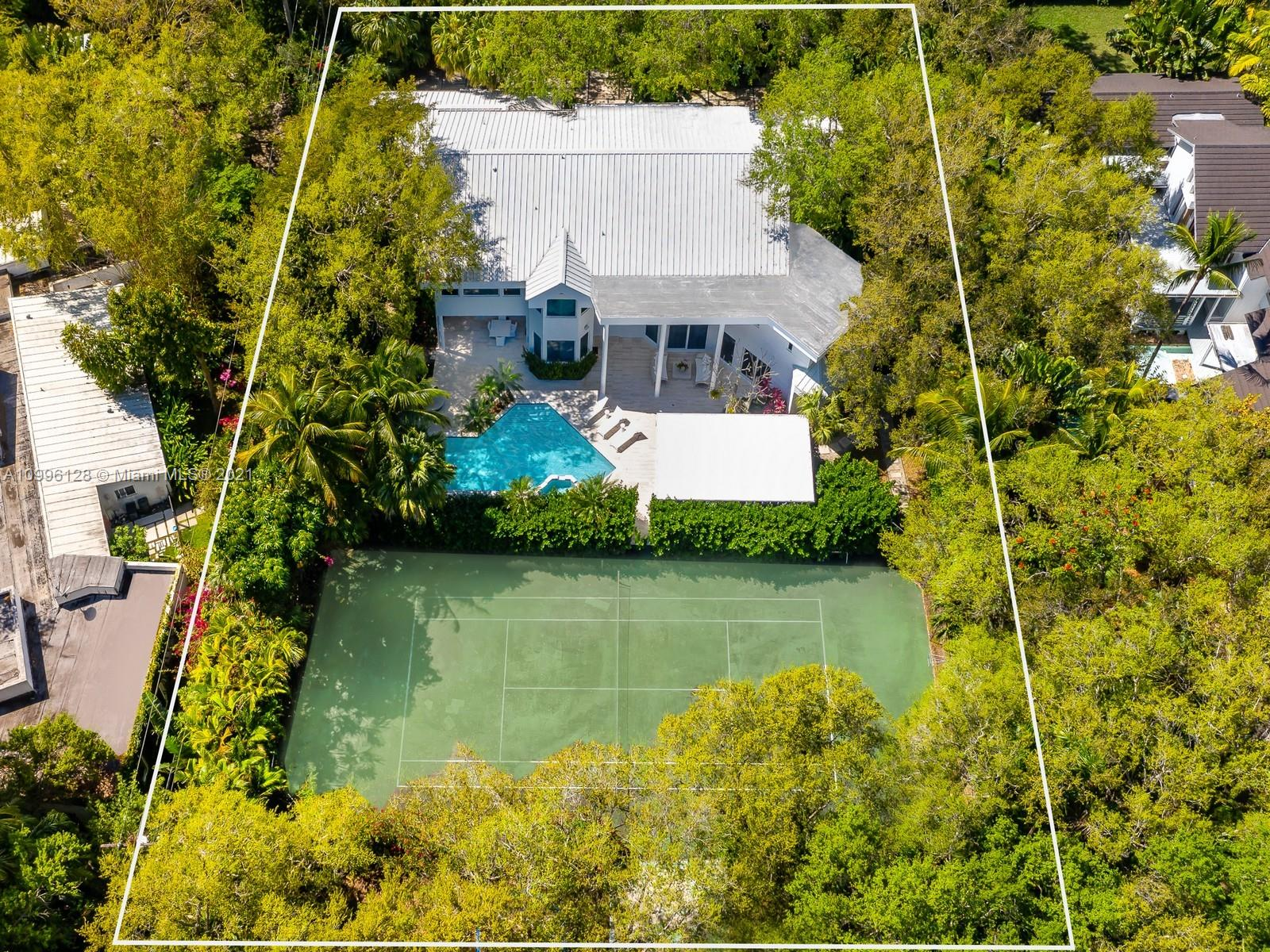 This MODERN Gem sits on nearly on a 38,161SF LOT nestled in a quiet enclave in CORAL GABLES.Take advantage of this unique opportunity to own a completely updated home featuring a tennis/basketball Ct,summer kitchen,pool+expansive garden made for entertaining.This beautiful home features 6 Bds,7 bths inside of its 7,090 SF Total,w flr to ceiling windows which provide ample light throughout the house.On the 1st floor offers formal living+dinning room,completely updated kitchen w top of the line wolf appliances+built in Nespresso Machine,office,guest suite,family room.Upstairs offers master suite w oversized his+her closets,+3 adtl bedrooms.Equipped with tin roof,generator,2 car garage+2 carports,impact windows throughout,surround sound+security system,this gated home is a family's dream!