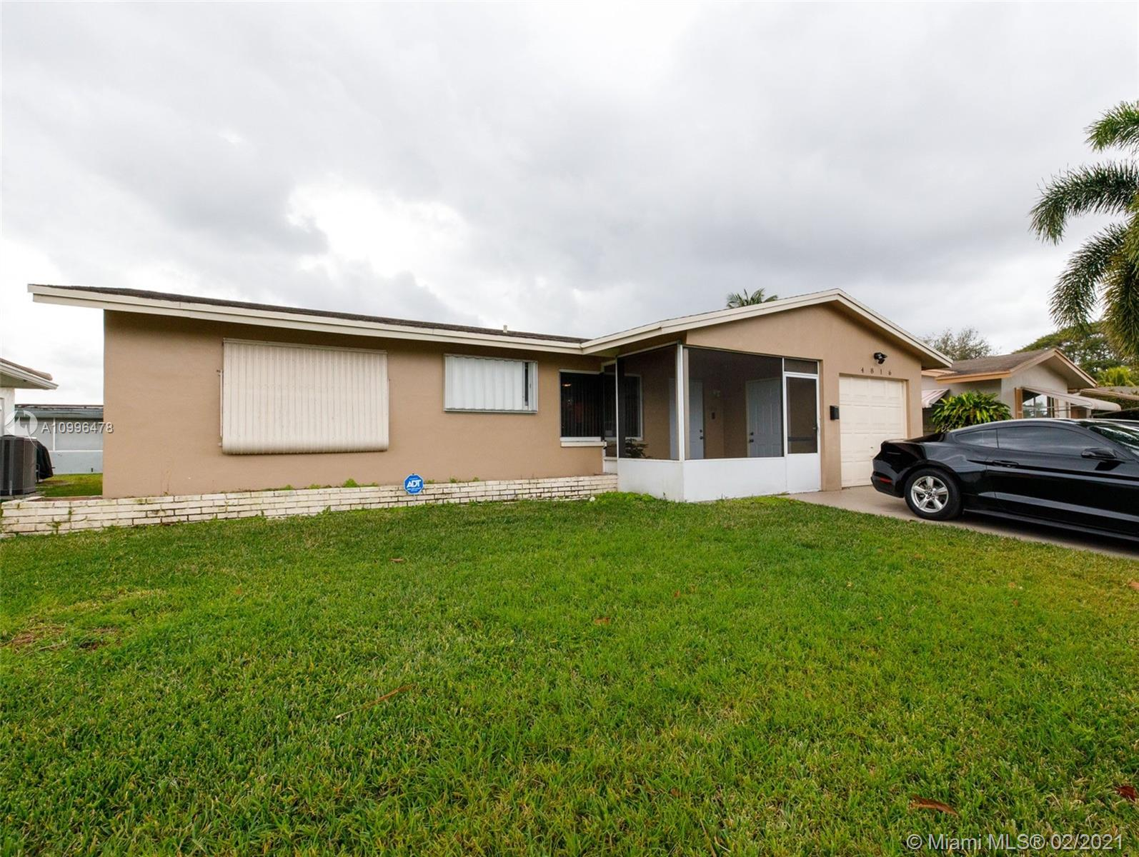 Highly sought after clean and quiet neighborhood. Beautifully renovated waterfront 2/2 w/ enclosed garage bonus room AND Florida Room! This home features a wine cooler, hurricane protection, stainless steel appliances, tile and laminate flooring, updated electrical and so much more. Low HOA dues. This property is a must see, this home will not last!! Motivated seller..bring your offers!!!