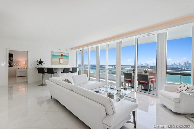 Experience some of the best views in Miami Beach from this renovated 2 Bedroom + Den/3rd Bedroom, 3 Bathroom (1,929 SF). Features include new bathrooms, White Marble flooring throughout, custom bar, LED lighting, custom closets, two private balconies with views of Biscayne Bay, Star Island, & Downtown Miami. Full service luxury building offers 24hr security, valet, concierge, fitness center & heated pool & spa. World class dining, entertainment & more!
