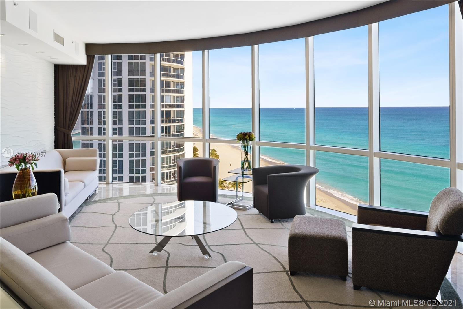 Spectacular beachfront residence, designer interiors by Steven G, gorgeous ocean views from every window, 4 beds (2 master), 4.5 baths, 2 gourmet kitchens, media room, bar. Building offers spa, gym, tennis, 4 pools, valet parking & 24 hour security. Consists of 2 combined units 1509 & 1507.