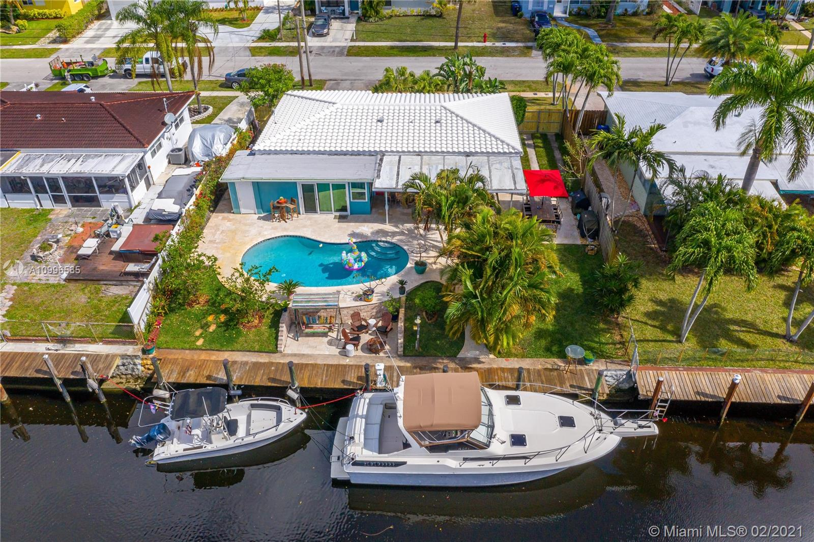 Gorgeous home with 70 feet of waterfront on canal opening to the New River, Deep water, NO FIXED BRIDGES to Ocean. Massive upgrades! Showcases a bright, open concept GREAT ROOM & KITCHEN!  Features a split bedroom plan with a huge primary bedroom and custom closets. Relaxing FLORIDA ROOM/poss 3rdBR. Large laundry room, w/deep washtub, & cabinetry. New Ceramic barrel style Roof and Impact windows, wood look ceramic tile floors, Plantation shutters, and A/C. Amazing Kitchen w/exquisite quartzite island & counters, Soft close drawers. Dock with electric (32AMPS) & water. Beautifully landscaped front & backyard, enormous Travertine patio and pool. An entertainers dream - complete with a fenced yard. Close to Las Olas, Downtown, Airport, and Fort Lauderdale Beach. SEE BROKER REMARKS.