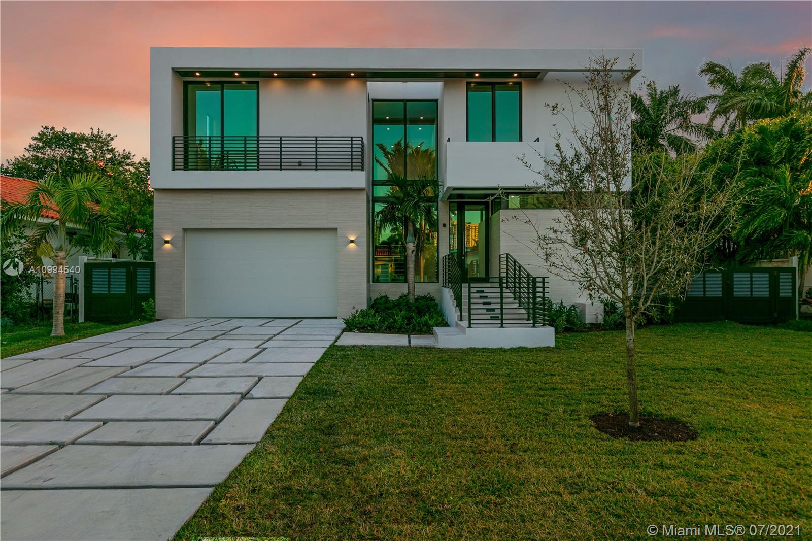 Inspiring brand new construction home in the world-renowned Sunny Isles Beach. The entrance greets you with a modern flow-through design and a custom floating oak staircase. This home features 5,267 sq.ft of living space including an 847 sq.ft rooftop terrace with 360-degree views of the Intracoastal waterway. 5 beds/5.5 baths, maids quarters, private elevator, Chef's kitchen, 2 car garage, rooftop and pool area summer kitchens, accordion impact sliding doors. Impact windows throughout with -Italian soundproof/trimless doors inside, private grassed play area. This home offers unparalleled finishes & impressive architecture made for any buyer looking for perfect combination of high-end finishes with contemporary design and outdoor luxury living. Walk to the beach. A+ School District