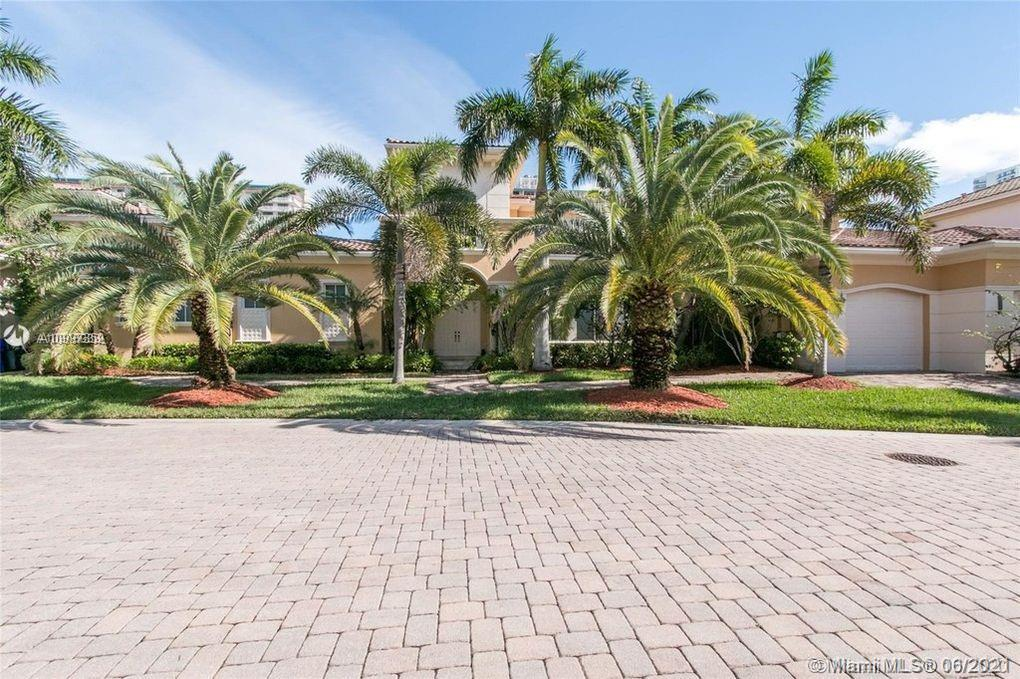 """Located 30 minutes from North Miami Beach, come discover a private Island neighborhood in Hollywood Beach. The very attractive and well manicured """"Three Islands"""" has direct water access and is located in close proximity to the beaches and the best shopping center in South Florida. This wonderful property built in 2004 offers you 5,800 sq. ft. 6 bedrooms, 7 baths with a 3 car garage on a large double lot. 110-ft dock & 20-ton boat lift offers intercoastal access with no fixed bridges requiring maintenance. Enjoy your private swimming pool, 2 Jacuzzis and your private spa that includes a regular and wet sauna. Enjoy this magnificent family home, feel enamored thanks to the detail-oriented landscaping. Filled to the brim with stunning modern upgrades. Dream home that won't last long!"""