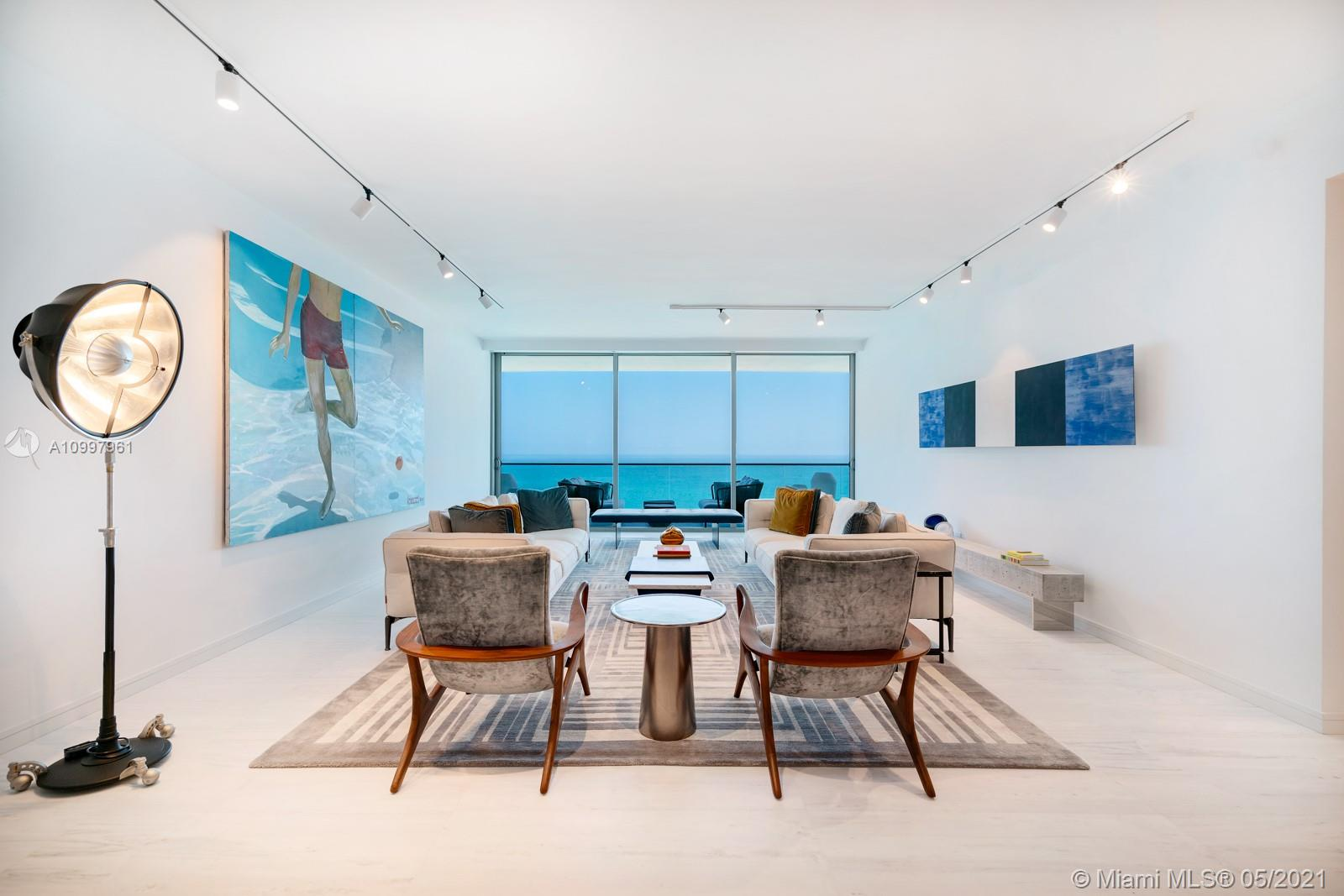 Made for a Design Aficianado! Let good taste reign. The direct Oceanfront residence features 2 Bedrooms + Den/ 3.5 Baths, an expansive 445 SF terrace to experience sunrise, ocean & sky views. This sleek beach pad sports beautiful honed pantelikon marble, tan oak floors in the bedrooms, & custom millwork throughout. The concept of open living/dining/kitchen is embraced and is ideal for hosting. The chef's kitchen features a stand-out calacatta marble center island, & top of the line Gaggenau appliances including a full-size wine fridge. The primary suite boasts a large walk-in closet finished by Italian firm Illimiti, direct terrace access & a stunning bath finished in marble & Ipe wood featuring a rain shower & large Boffi soaking tub. The property is to be appreciated and properly priced