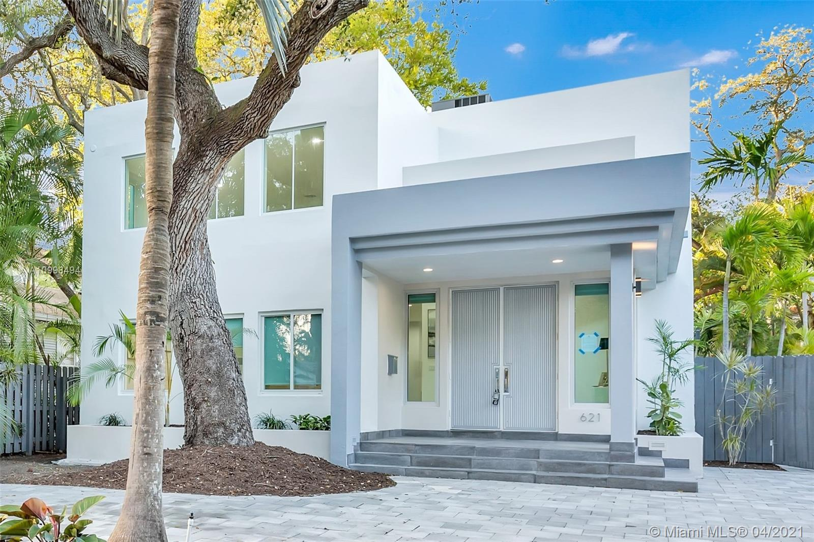 Beautifully remodeled 2 story home in the tree lined Rio Vista neighborhood. Located just south of the New River, with easy access to Las Olas Blvd and Downtown Ft. Lauderdale. The spacious home has 3 beds/3 baths in the main house with a separate 1/1 guest house with kitchen. The home includes a formal living room, dining room, family room and expansive kitchen.  Recently added glass railing on the balcony of the master bedroom looks out to the welcoming pool and the beautiful tree canopy.
