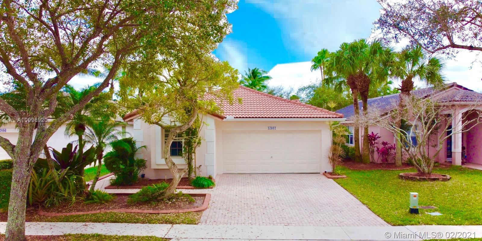 Beautiful 1 story home located in the much sought-after community of Pembroke Isles. This home features an open floor plan, vaulted ceilings, stainless-steel appliance. Wood floors on bedrooms and tile flooring throughout the entire home with spacious bedrooms, a walk-in closet, and more. The exterior features a  YARD with more than enough space for a pool. HOA includes- lawn maintenance, cable, ADT security, 24 roaming security, clubhouse, 4 pools, tennis, soccer, basketball, and more. Resort-style living with excellent A-rated schools.
