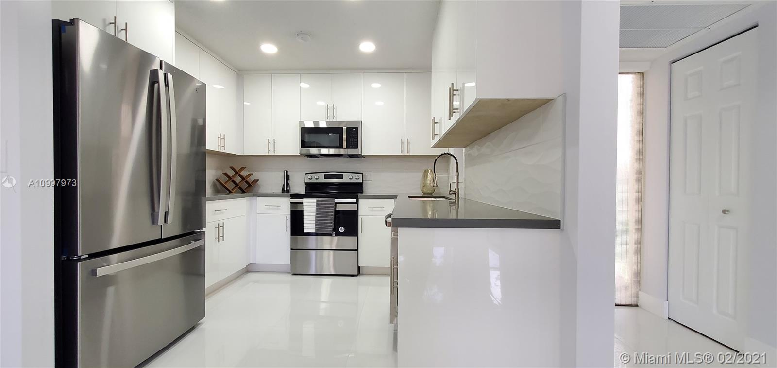 Wow! Nicest unit at the wonderful Baywood Village I. Forget the rest and bring your pickiest client to see this rarely available, completely remodeled, 1st floor corner unit with over 1,100 sqft of beauty and attention to detail. New kitchen with custom made cabinetry, Quartz counter-tops and all new SS appliances. New bathrooms with modern shower panel and glass shower door. New High-End 24x24 porcelain tiles with new baseboards. All new LED lighting. New full size washer/dryer. New water heater. New Electrical Panel and less than 2 yr old A/C! Accordion shutters all around. Pets OK up to 25lbs! No rentals 1st 2 yrs. Association has reserves and requires 5% down.Please read all remarks & attachments before calling or submitting your offer.NO NEED TO CALL FOR STATUS IF ACTIVE. SHOW & SELL!