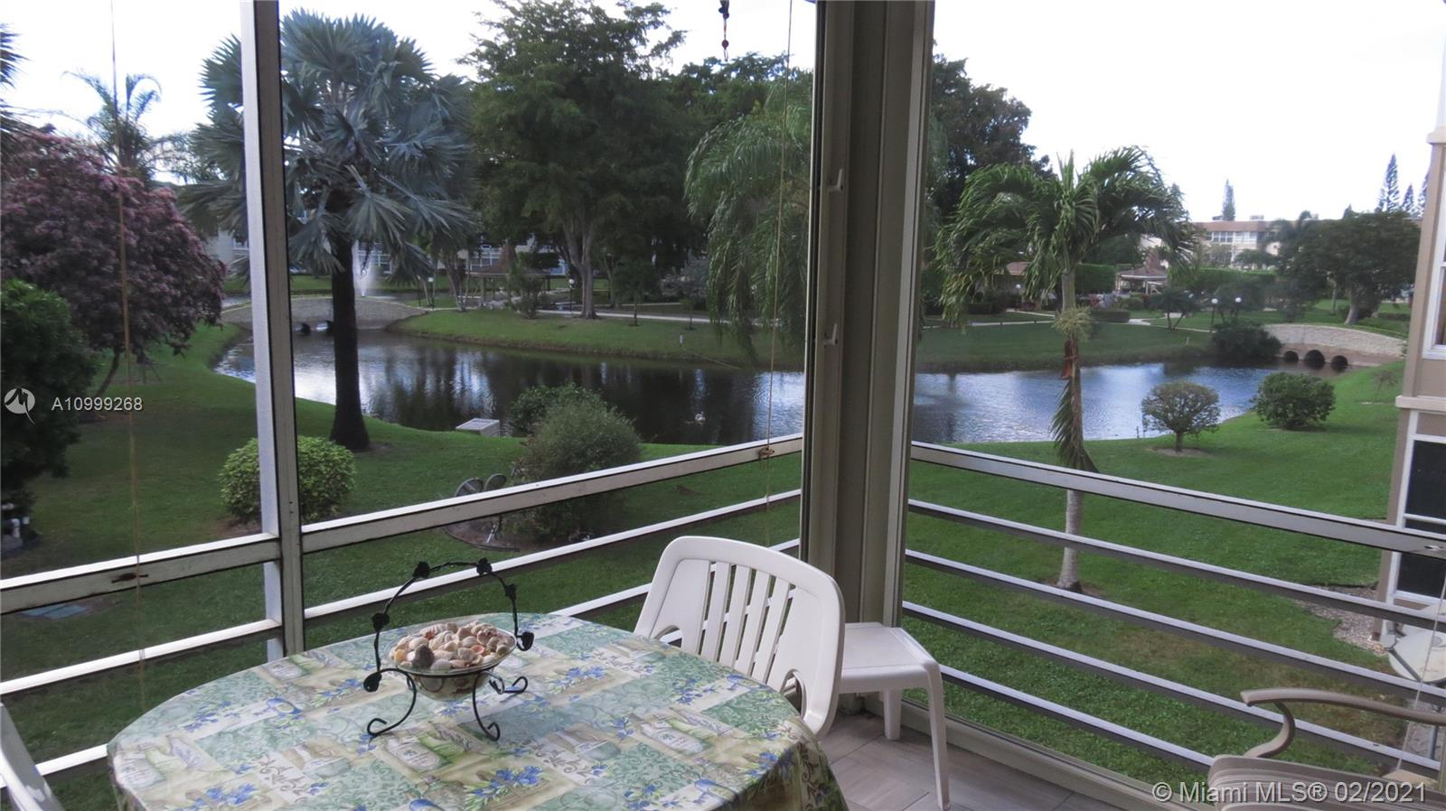All turn key furnished very nice bright 2 bedrooms 2 bathrooms on second floor with a beautiful view of the lake. Tile flooring throughout. Very spacious unit with a lot of storage and large closet in master bedroom. Nice patio with updated tiles and hurricane shutters. Very active well maintained community. Close to shopping, Publix, Walmart, Pharmacy, dining. About 15 minutes to the beach as well as the Fort Lauderdale Airport. Low maintenance fees.