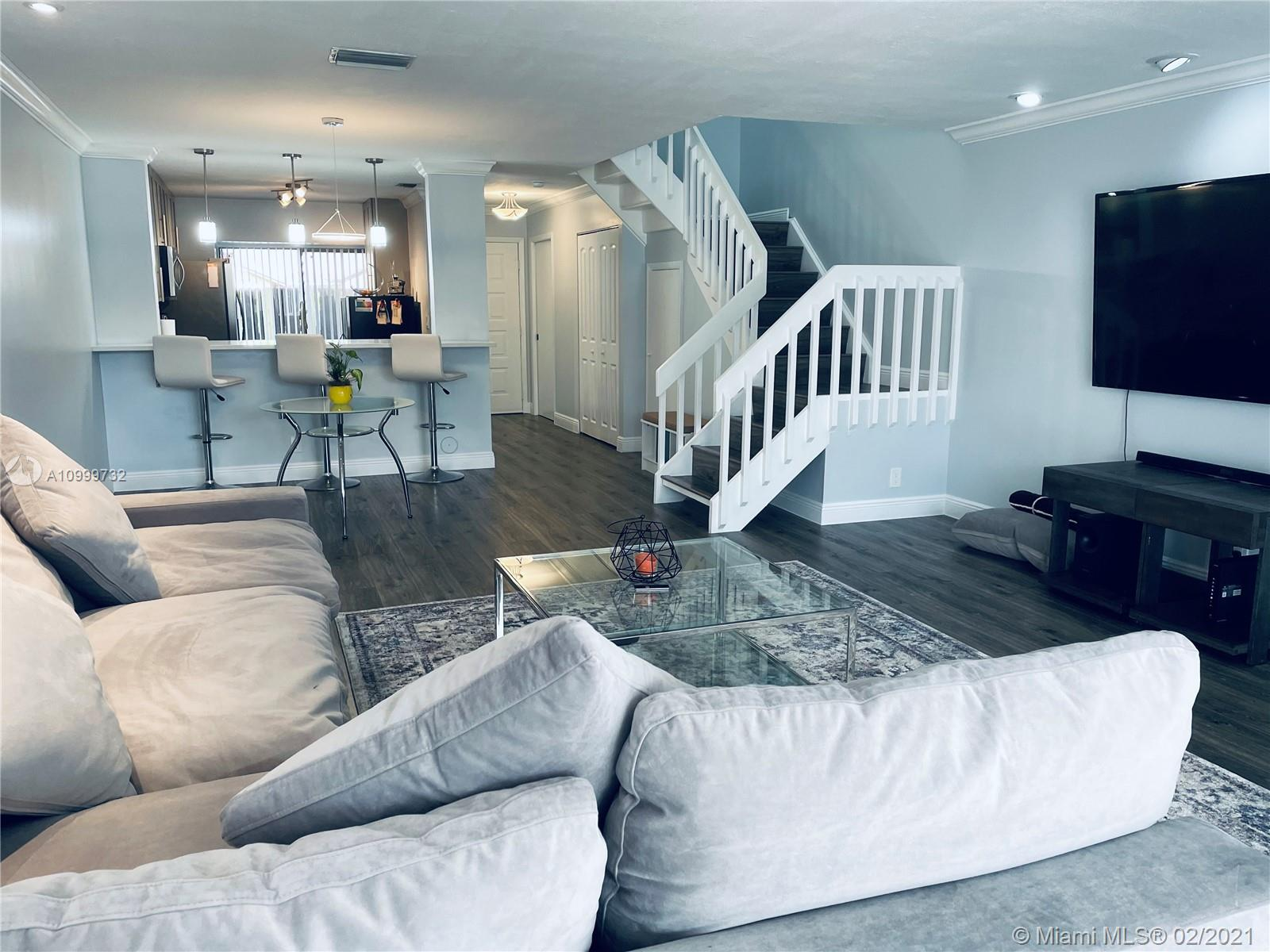 """Modern townhome, with a lake view. Appliances are less than two years old. All bedrooms and two full en suite bathrooms are located on the second floor, half bathroom is located on the first floor. Master bedroom has a walk-in closet and a shower. Second bedroom's en suite has a bathtub. Property is """"AS-IS"""" HOA has reserves."""