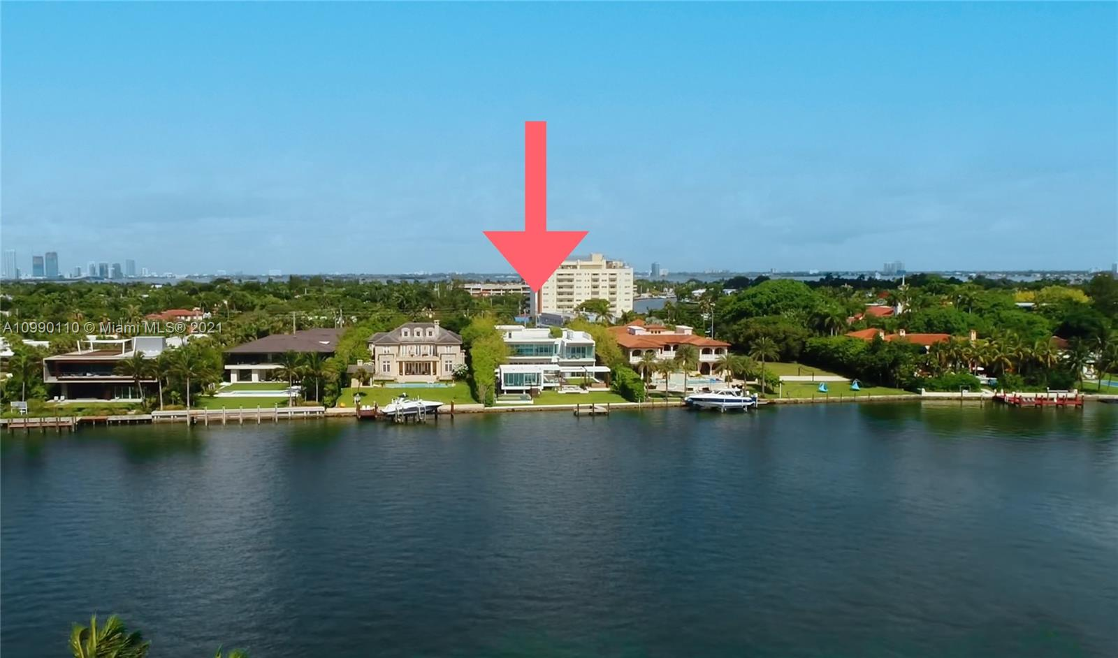 OVER 1 ACRE WATERFRONT FAMILY COMPOUND ON PINE TREE DRIVE WHERE MENIN HOMES GOES MODERN FOR THE 1ST TIME IN COLLABORATION WITH RENOWNED SWEDISH-MEXICAN DESIGNER ALEXANDER DIAZ OF ATRA FORM! Delivering Late Summer 2021. Estate Sits on Wide Portion of Intercoastal. 13,178 SF w/ 9 Beds, 9 Baths + 3 Powder Rooms. Stunning 3x7 FT Italian Seashell Stone Floors T/O. Open Living Area w/ Fluted Travertine Floating Fireplace. Chef's Kitchen w/ Calacatta Gold Marble Countertops + Wolf, Miele & SubZero Appliances. Theater w/ Top-of-the-Line Surround Sound. Cladded Matte Bronze Staircase + Elevator. 3,000 SF Master w/ Private Pool, Gym, Sauna & Ocean Views. Rooftop w/ BBQ Grill. Deck w/ Saltwater Pool + Spa & Summer Kitchen. Glass Padel Court, Basketball Court, Outdoor Study. Smart Home Automation.