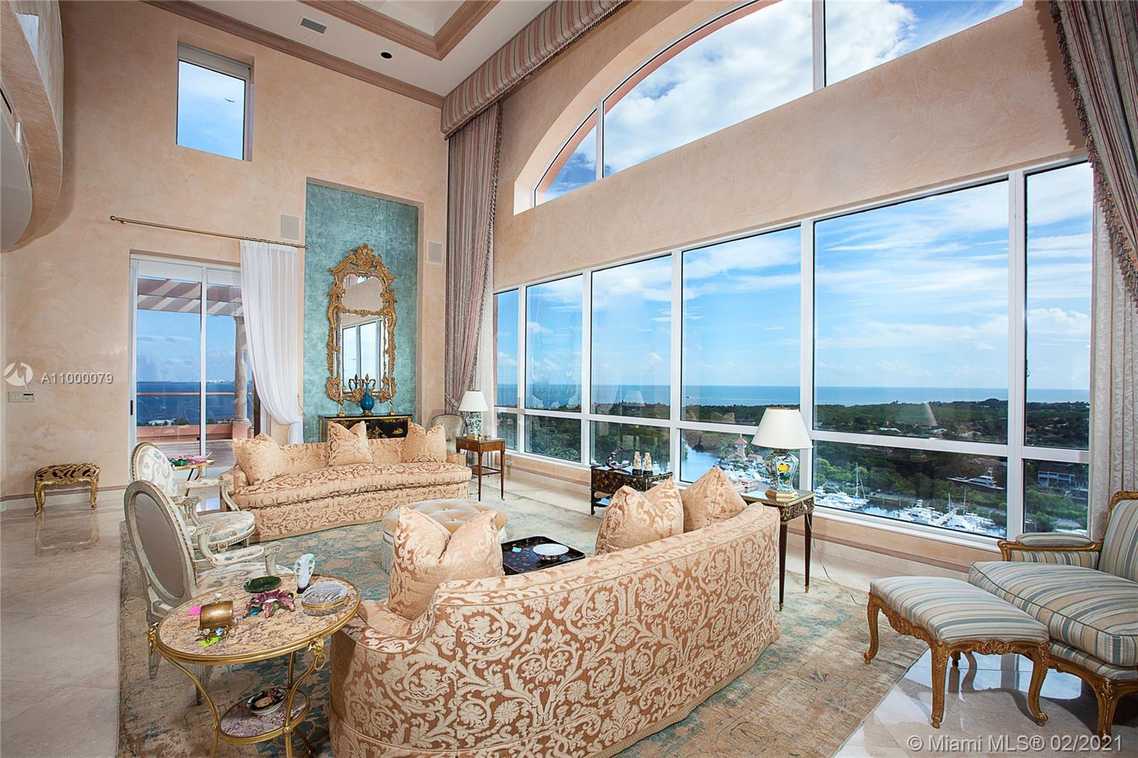 This stunning 6BR/6+1BA Tower Suite in Coral Gables is an Estate in the Sky offering 10,190 SF of luxury spanning 2 stories. Home features a private elevator, fine marble floors, Venetian plaster walls, crown moldings, a beauty area/massage room, a theater & a large library. The spacious great room boasts double high ceilings & walls of glass plus a private dining salon both w/amazing views. The eat-in gourmet kitchen sports top-of-the-line-appliances & has a separate breakfast area. An elegant 2nd floor principal suite w/double high ceiling, seating area & beautiful principal bathroom. 6 terraces provide endless views to Biscayne Bay, Miami Beach, Key Biscayne and to downtown Miami. Unit includes 6 parking spaces & a storage room. 5-star amenities complete this amazing offering.