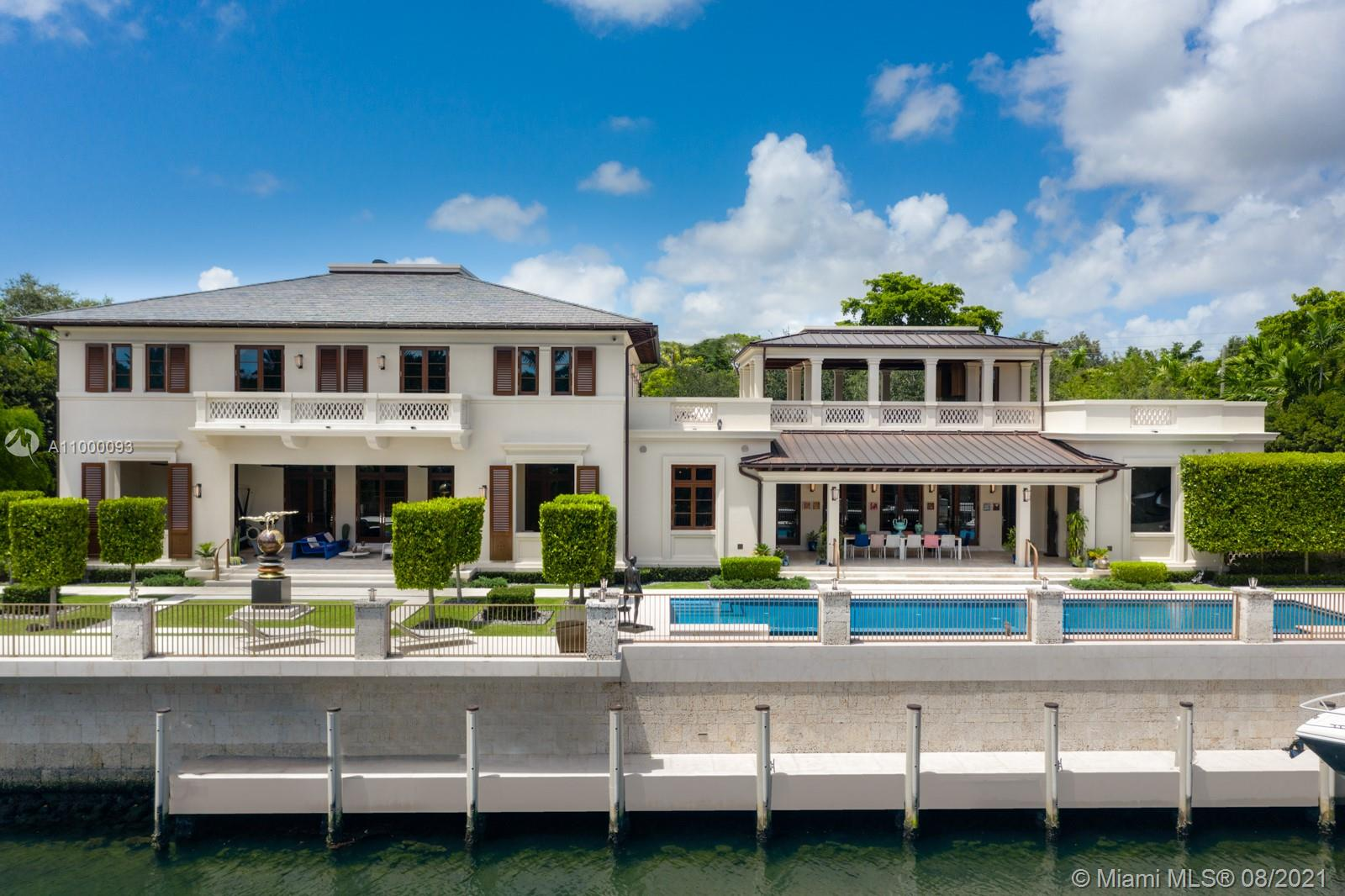 Inspiration meets sophistication. Custom built for the current owners with top of the line materials and exquisite finish.  A remarkable 200' waterfront, easy access to Biscayne Bay. Impressive marble pillars greet you as you enter the home. Outdoor spaces that blend organically with the Gallery walls, cohesive wall-to-wall marble floors, tray ceilings w/stunning gold and silver brushed metallic, elegant venetian plaster walls. Immaculate chef's kitchen w/ emerald quartz countertop & waterfall island. 2 elevators & service quarters. Bay breezes from the covered terraces & the second level gazebo with entertaining in mind. Glass mosaic tile infinity edge pool coincides with the coral rock wall that lines the waterway. Complete with a 3-car air-conditioned garage. A truly awe-inspiring home.
