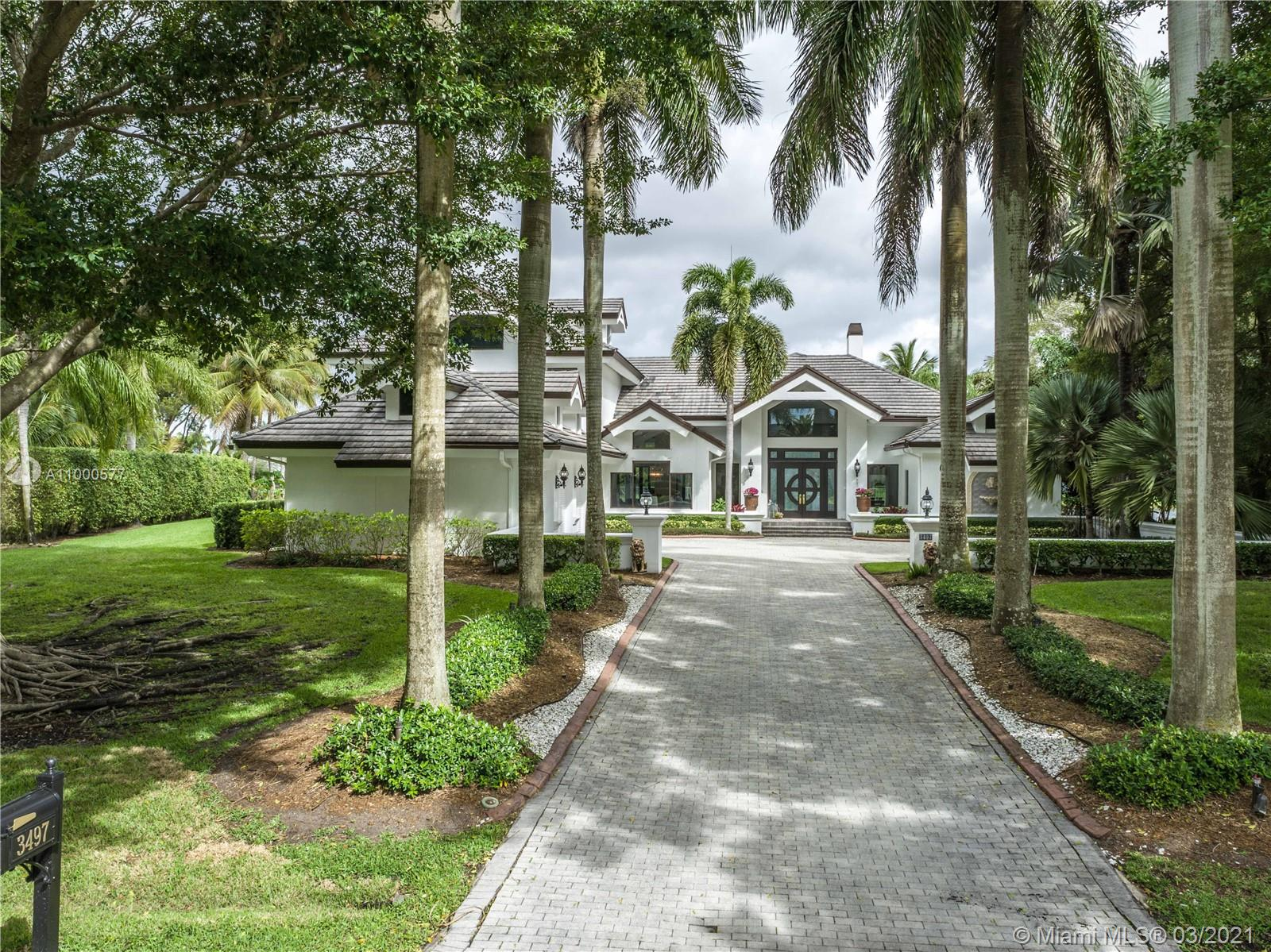 Florida living at its finest, welcome to this elegant 1.1 acre waterfront home in Windmill Ranch Estates. Setback on a long, private driveway this 6 bed/ 6.5 bath home is an entertainer's delight. Sleek, modern & neutral throughout with the perfect distribution for a large family. Dramatic light filled foyer leads to the formal living room with contemporary fireplace, soaring ceilings and panoramic water views. State of the art chef's kitchen with top of the like cabinetry and appliances. Spacious backyard with modern style pool, spectacular water views and plenty of room for the kids to play.