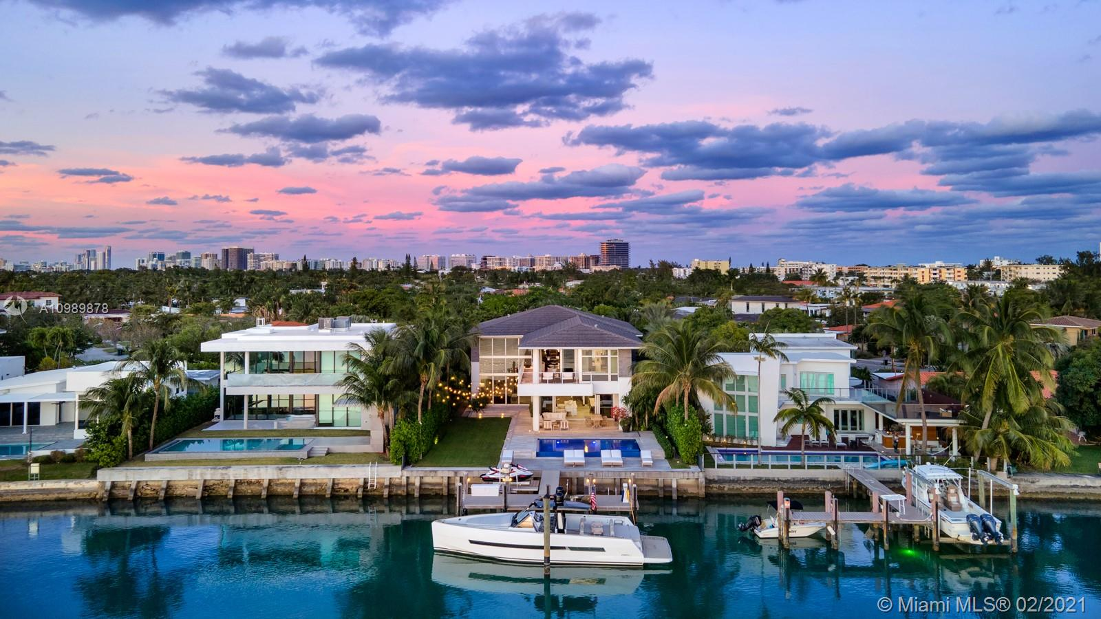 This stunning modern villa with 7,451 SF of construction and 5,600 SF under AC is Biscayne Point's most desirable listing. The south facing, 11,250 SF lot offers a sun exposed pool all day with 75 FT on Biscayne Bay. Large manicured garden and full outdoor kitchen are perfect for entertaining your friends and family. Fully integrated smart home powered by Savant. Italian kitchen with Sub-Zero/ WOLF appliances. Service quarters with bedroom / bathroom. Five minutes from Bal Harbour Shops and 10 minutes from the heart of South Beach.
