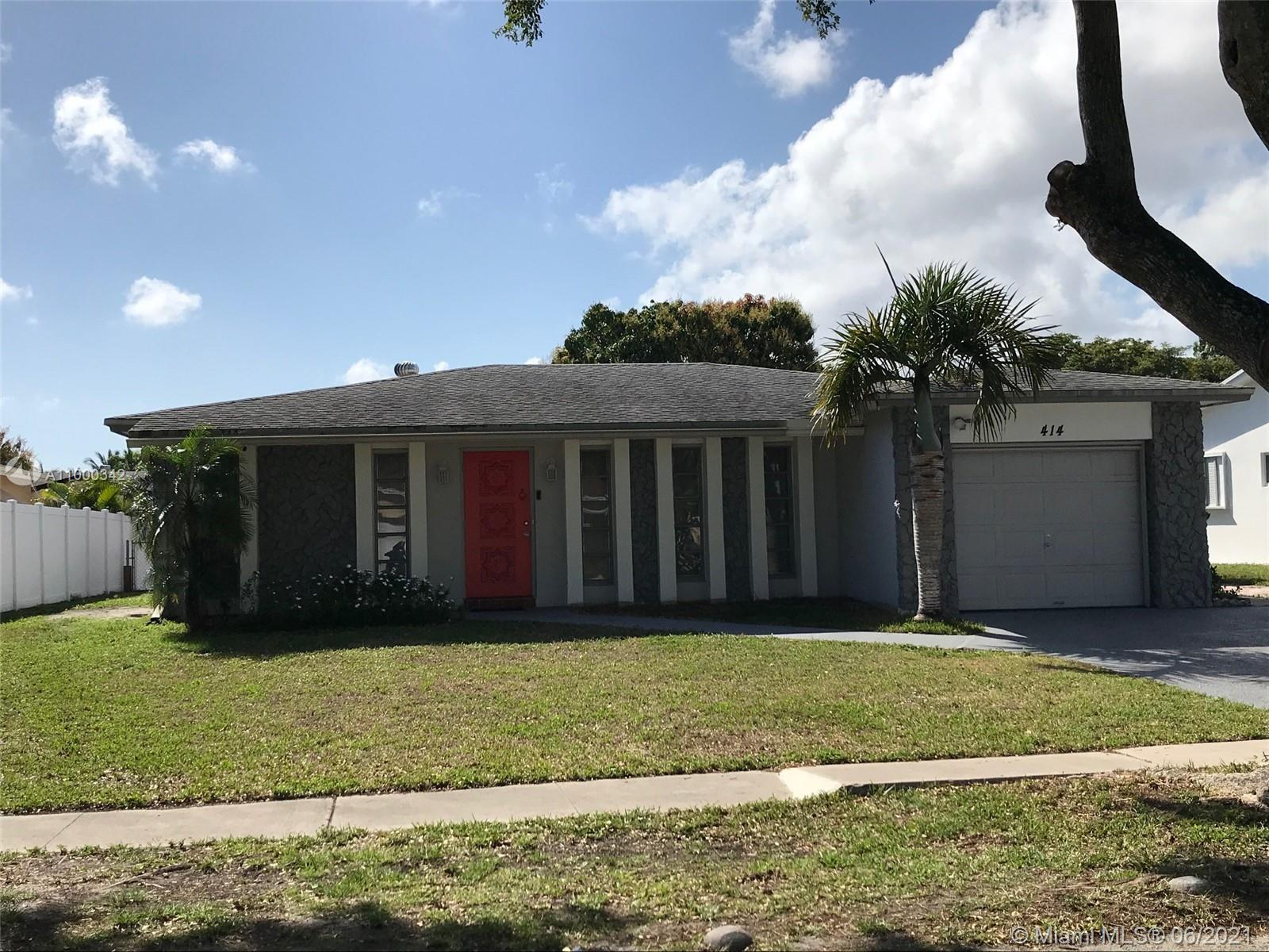 BEAUTIFUL 3 BED, 2 BATH HOME WITH GARAGE, PLUS A CLOSED-IN PATIO W/AIR CONDITIONING,ROOM MEASURES 28FT X 17FT, YOU WILL LIKE THIS ROOM WITH MANY WINDOWS ,VERY BRIGHT,  PLUS A VERY LARGE WOOD DECK, A PLACE TO ENTERTAIN AND RELAX. (LOOK AT  PICS), HOUSE FEATURES STAINLESS APPLIANCES,SPACIOUS ROOMS,TILE AND ENGINEERED WOOD FLOORS,WASHER, DRYER. VERY CLOSE TO THE BEACH AND THE FT LAUDERDALE INTERNATIONAL AIRPORT, GULFSTREAM VILLAGE, AND THE AVENTURA MALL. DON'T MISS OUT ON THIS HOME, WON'T BE ON THE MARKET VERY LONG. NOTE: HOT TUB NOT INCLUDED IN SALE.