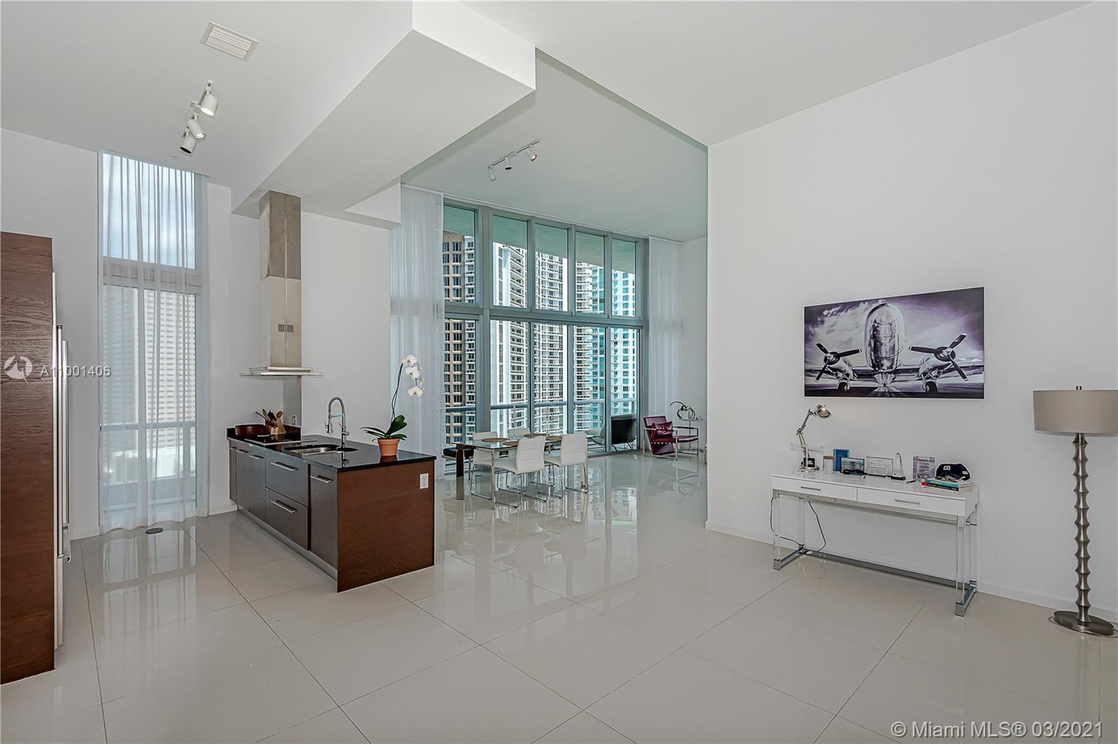 """FURNISHED LOFT UNIT 22 FT CEILINGS/2ND BEDROOM REMOVED TO CREATE TRUE NY LOFT FEEL , CORNER WITH WRAPAROUND GLASS BALCONY & SWEEPING VIEWS OF SPARKLING BISCAYNE BAY FROM ALL ROOMS. A FOYER ENTRY WELCOMES YOU TO A SPACIOUS OPEN FLOOR PLAN FLOODED WITH NATURAL LIGHT & GLEAMING FLOORS THROUGHOUT. KITCHEN APPLIANCES ARE TOP OF THE LINE (SUB-ZERO, WOLF, BOSH). THE MASTER SUITE WILL TAKE YOUR BREATH AWAY SEPARATE WALK-IN CLOSET, SPACIOUS BATHROOM FEATURES JACUZZI TUB, LARGE SHOWER ENCLOSURE & DUAL SINKS. THE COMPLEX AMENITIES INCLUDE ONSITE STATE-OF-THE-ART SPA, AEROBIC STUDIO, WEIGHT & SPINNING ROOMS, CLUB-ROOM, SCREENING ROOM. EASY ACCESS TO BRICKELL CITY CENTER, AREA RESTAURANTS & TROLLEY. THIS IS A HOME IN THE SKY WAITING TO WELCOME ITS NEW OWNER!"""""""