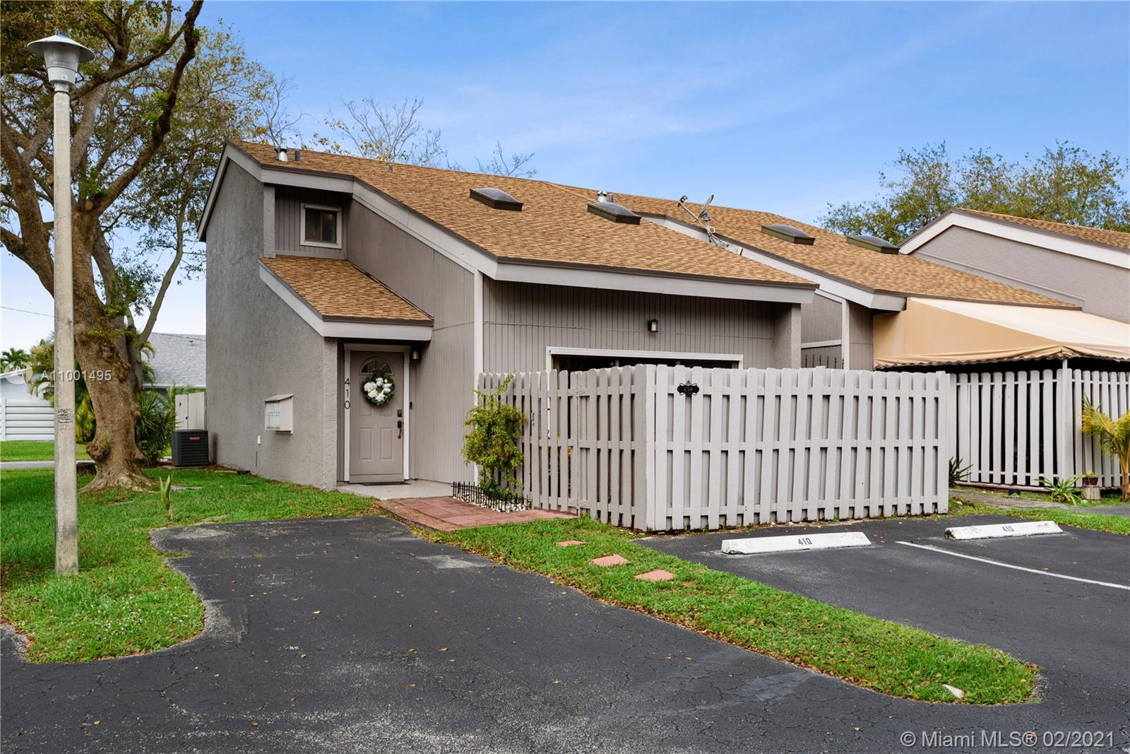 This exclusive townhome corner unit is an update galore! Feels like a single family home, this desirable 2beds/2baths opened floor plan features a two story high ceiling w/attractive skylights, a dining room, a livingroom, a laundryroom, walk-in closet, plenty of storage, a fenced front yard, a patio and a terrace off the master bedroom. The house has newer porcelain look-like wood flooring throughout the first level, newer appliances and AC unit replaced 2016. A spacious laundry room with cabinets is located on the ground floor. The entire home offers plenty of storage . The low HOA ($185/m) covers water, sewer, community pool, and much more. The development was repainted in 2016, new roof 2017. Located close to the beach & airport. Contact me quickly as this will not last on the market.
