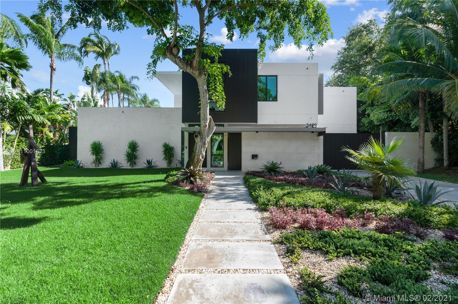 Welcome to the Moorings. This exquisite home was designed by Roney Mateu in a Modern Miami style. New 2019 construction offers effortless 21st-century luxury living & timeless sensibility. Every inch of its 5,936 SF is scaled to full advantage. Sky-high glass walls welcome natural light & frame the lush landscape & 63-ft pool w/waterfall. Marble and oak plank floors throughout. Ultimate Scavolini Italian kitchen w/Gaggenau appliances; sleek baths; full gym; staff suite. The private, gated Moorings enclave boasts 24-hr security & 3 parks within its intimate bayfront confines; from its coveted Main Hwy address walk or bike to top-tier schools, downtown Grove restaurants & shops.
