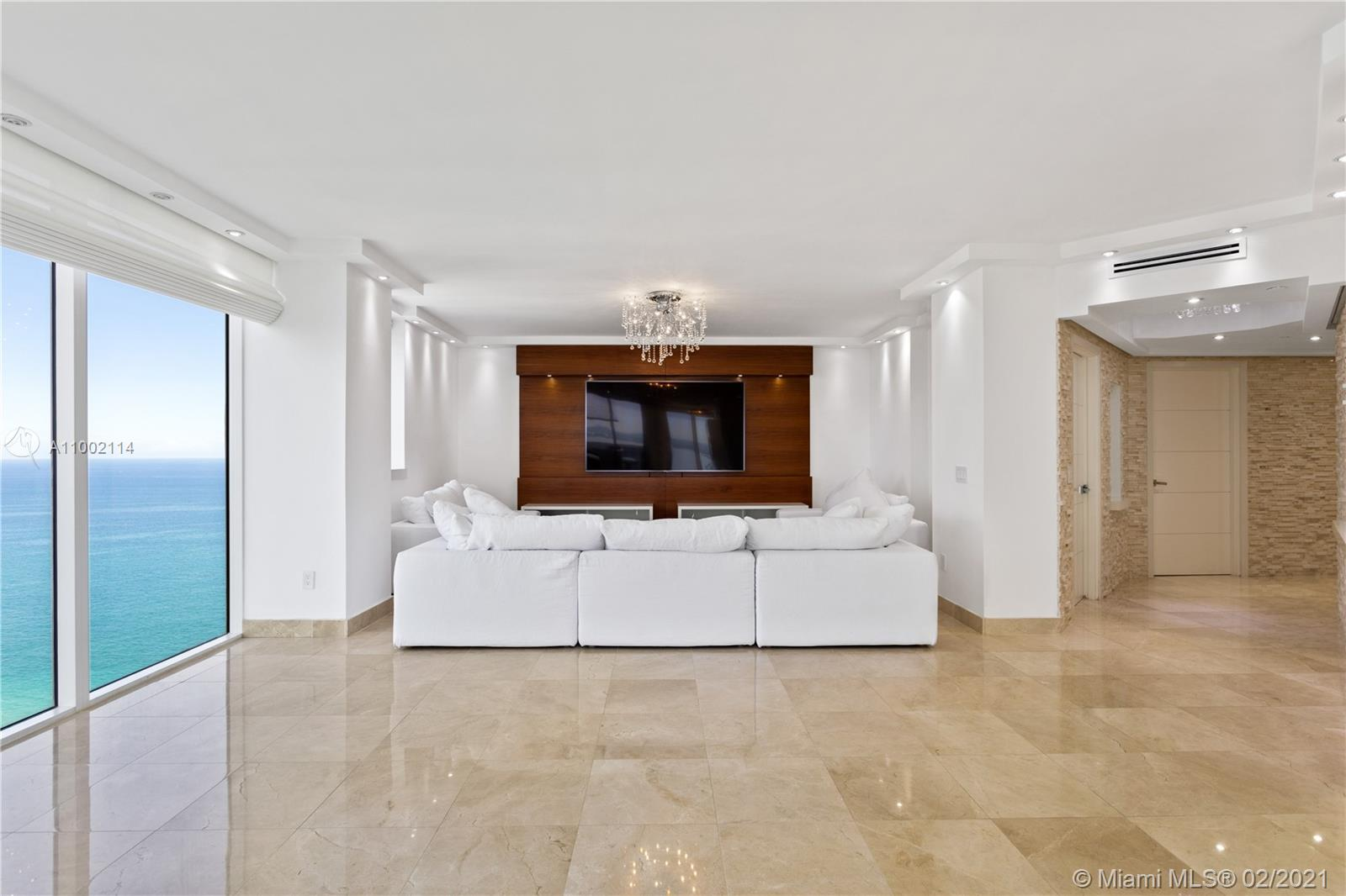 As you enter into this completely renovated residence, you will be greeted with spectacular views of the Miami skyline, bay & ocean. Sitting high up in the sky on the 37th flr, this unit boast an expansive flr plan which compliments those magnificent views. Originally a 2-bed & 2-bath, the second bedroom wall was open up to create a large living-dining room area. This can easily be reverted if the second bedroom is needed. The main bedroom includes a custom built walk-in closet. The bath is outfitted w/double sinks and a glass large shower. Fabulous open kitchen, marble floors, floor-to-ceiling windows, spacious wrap-around terrace, electric shades throughout and more exquisite details are found throughout this residence.