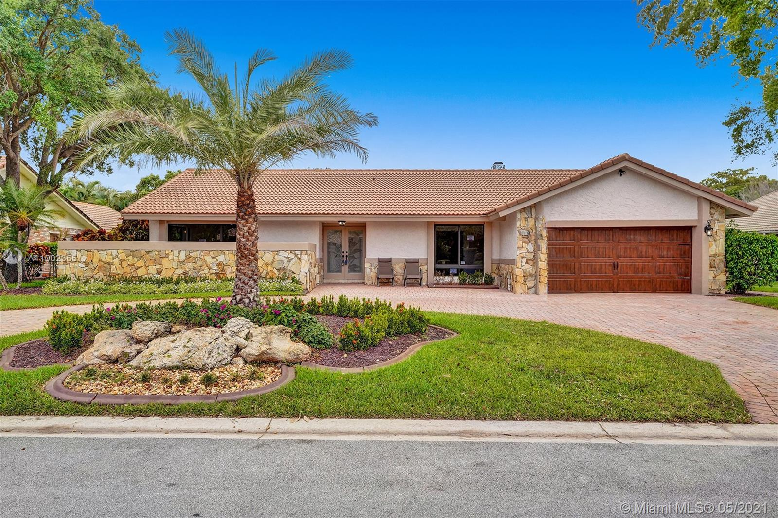 This is a grand opportunity for someone who likes things their way. This seller is willing to accommodate this buyer with their choices from his selections of kitchen and bathrooms. Currently, the home has beautiful tiled flooring, high impact window and doors, gorgeous stained tinted glass front door, French doors leading to the pool, barn door in master bedroom, master bathroom has an atrium and window, double vanity baths, beautiful pool area with brick pavers with full out door kitchen with full brand new barbeque area with pass through window with a dome screen.