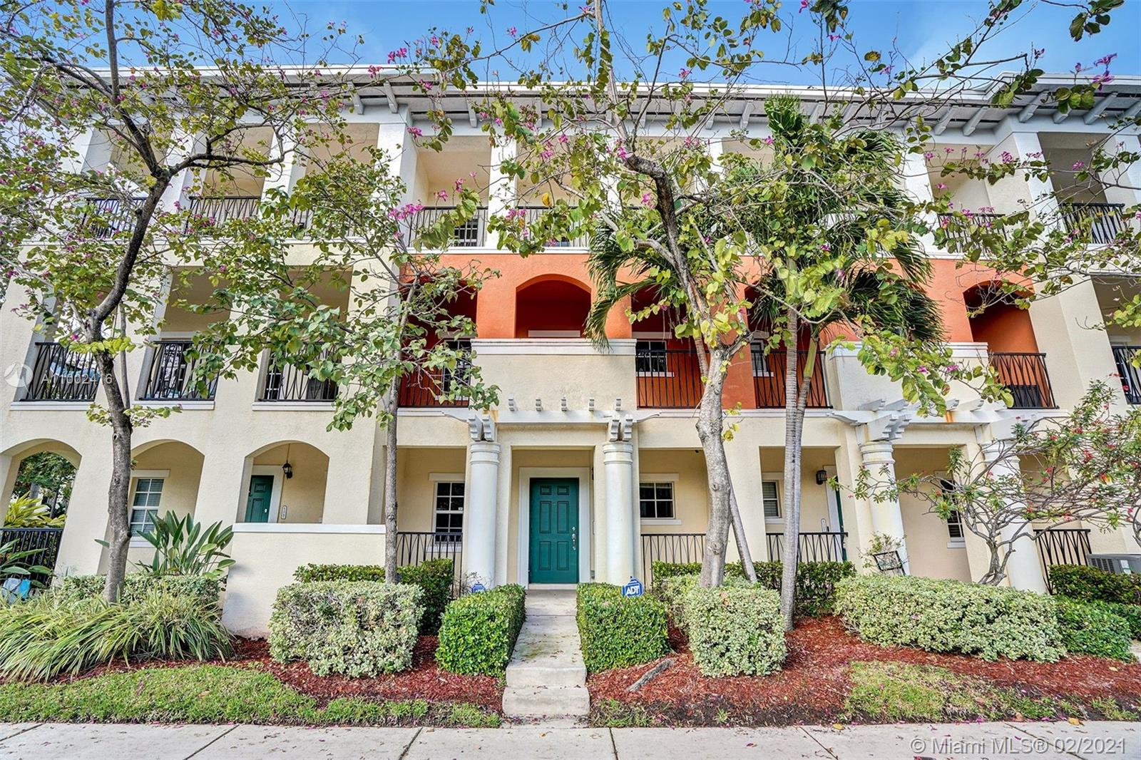 Nicely maintained three story townhome in Pompano Beach.  This 3 bedroom, 2 full bath and 2 half bath townhome and 2 car garage is located less than 3 miles to the beach.  1st floor has a bonus room, which can be used for home office or play room with half bath.  2nd floor has your living quarters, large dinning room, kitchen and living room.  So many different ways to design this floor.  3rd floor has all 3 bedrooms and washer and dryer.  Newly painted a soft gray color.  Community grounds offers walking paths along the lake as well as a community pool and exercise room.