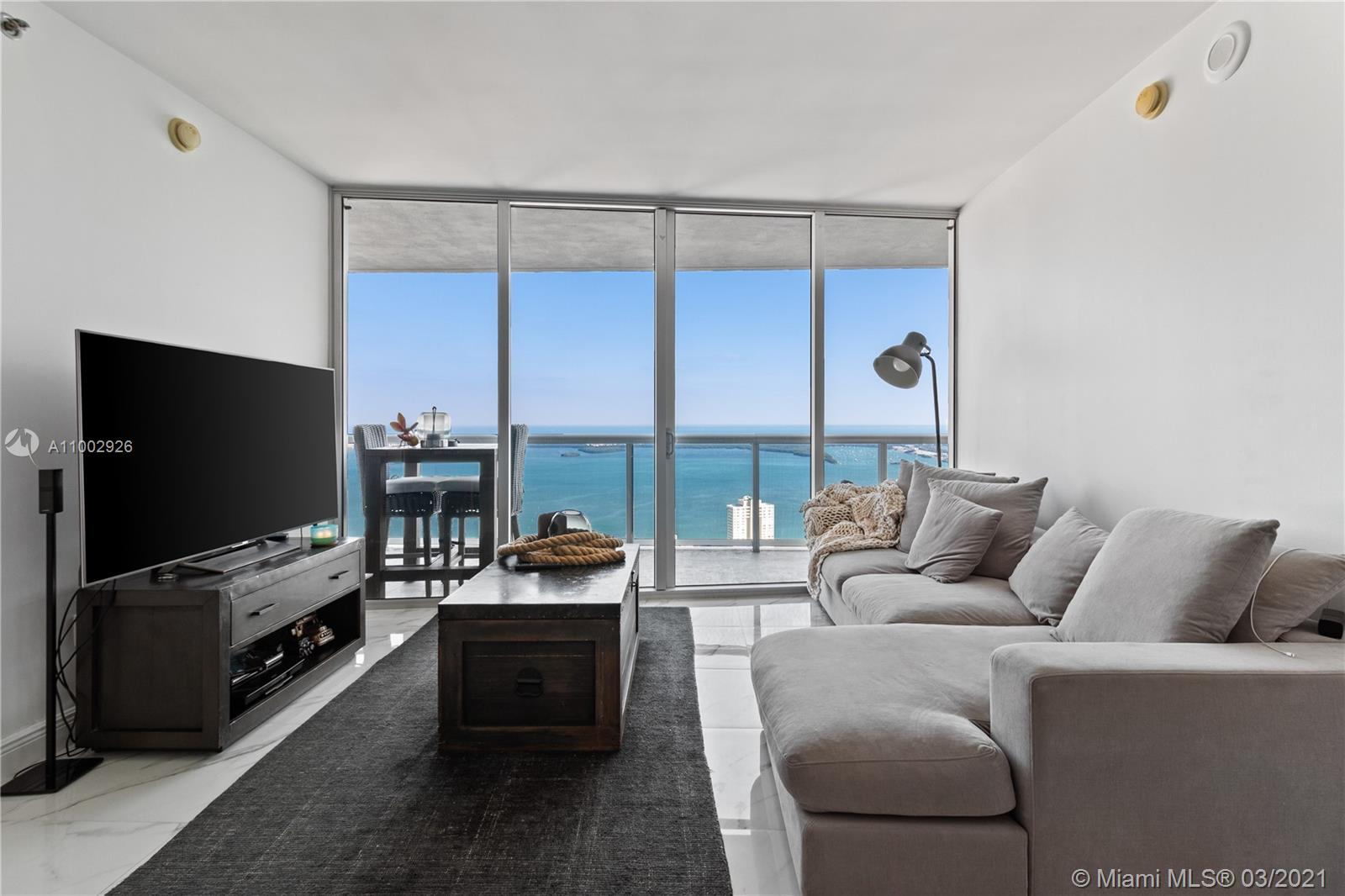 TENANT OCCUPIED TILL JULY 31ST. Breathtaking views of the bay and the ocean from this 2/2 +den on the 55th floor. Marble tiles throughout the unit. Italian kitchen cabinetry and Subzero fridge. Enjoy the pleasure of living in your own secluded condo while being in the epicentre of vibrant Brickell. The Icon Brickell has the best amenities including a world class Spa, a state of the art fitness center and the biggest pool in Florida. Walking distance to Brickell City Center