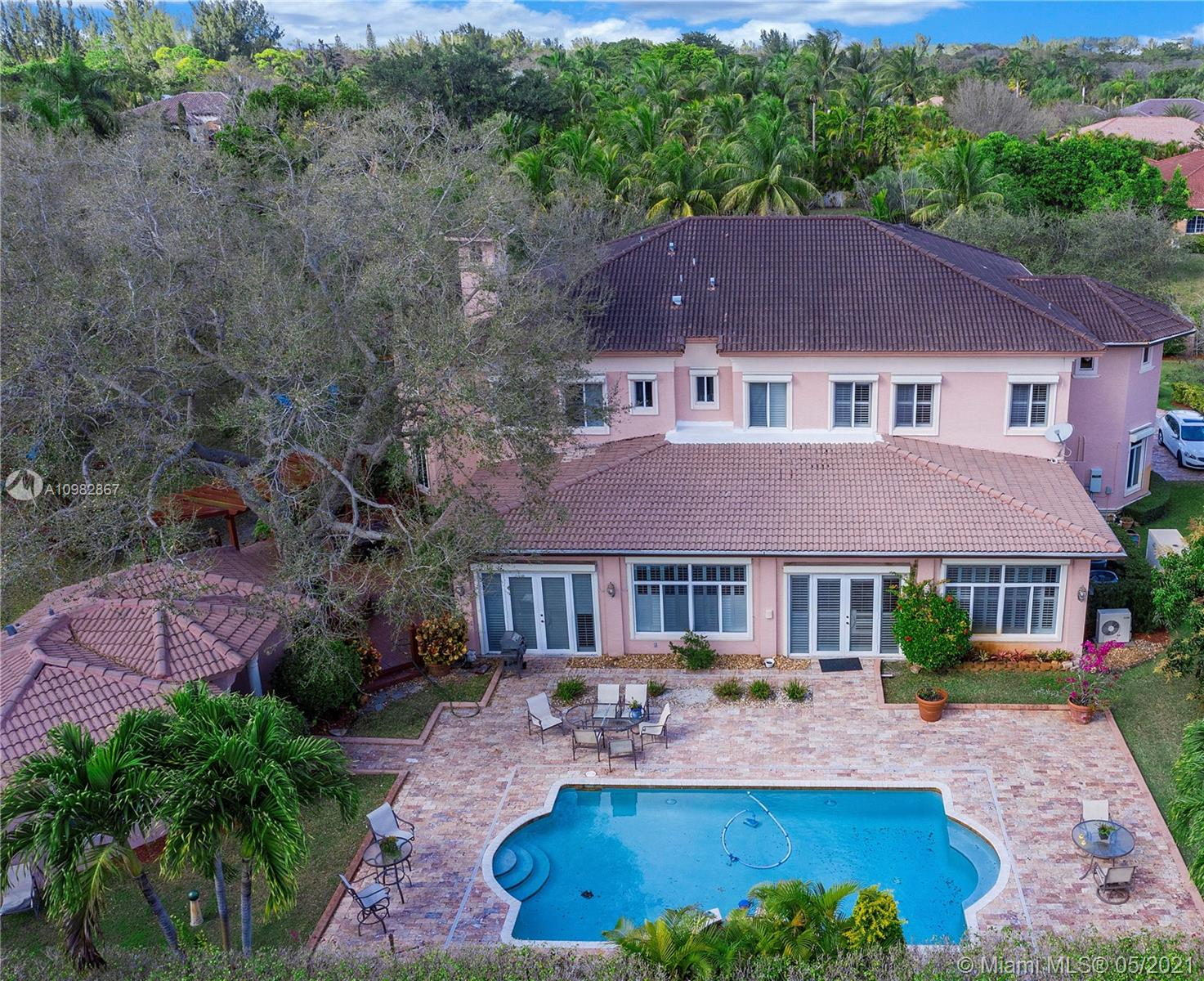 An Italianate Estate nestled on an oversized corner lot with lush landscape, Pool, and Guest House. Enter the Main House through a double height Foyer with gracious open staircase. First Floor contains a formal Living Room, polygonal Library, octagonal Dining Room, Family Room with Bar, gourmet Kitchen with eat-in Breakfast area, large Florida Room, Laundry Room, Bedroom, and two-car Garage. Second Floor encompasses a giant Master Suite, three large Bedrooms with in-situ Bathrooms and walk-in Closets, a central Hall/Gallery, and Loft/Media Room. No expense was spared in the creation of this home with plenty of room for entertaining and family living. Abundant natural daylight, luxurious finishes, stone flooring, ceiling coffers, and detailed mouldings characterize this unique residence.