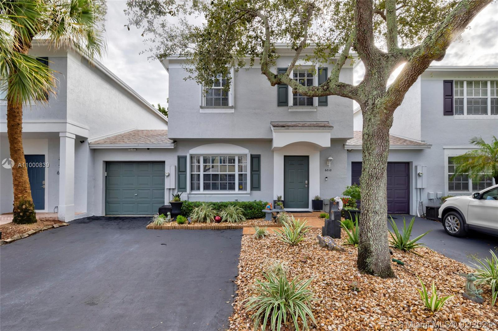 Wow no expense was spared in this beautiful 3/2.5 move in ready townhouse in fabulous Plum Harbor.  Open floor plan with neutral tile on the first floor and carpet on the second. Exquisitely remodeled designer kitchen featuring Quartz countertops, shaker cabinets, S/S appliances, and custom pantry (2019). Large master suite, with walk-in-closet, and new frameless shower enclosure in the master bath (2020). Big secondary bedrooms and updated vanity in the upstairs bathroom (2019). Exterior Patio sitting area was rescreened (2019) and fenced in  beautiful outdoor paver patio grilling station with solar powered lights, tankless w/heater. Modern paint inside and out, beautiful curb appeal, smart features including thermostat, downstairs lighting, keyless entry, and the list goes on.
