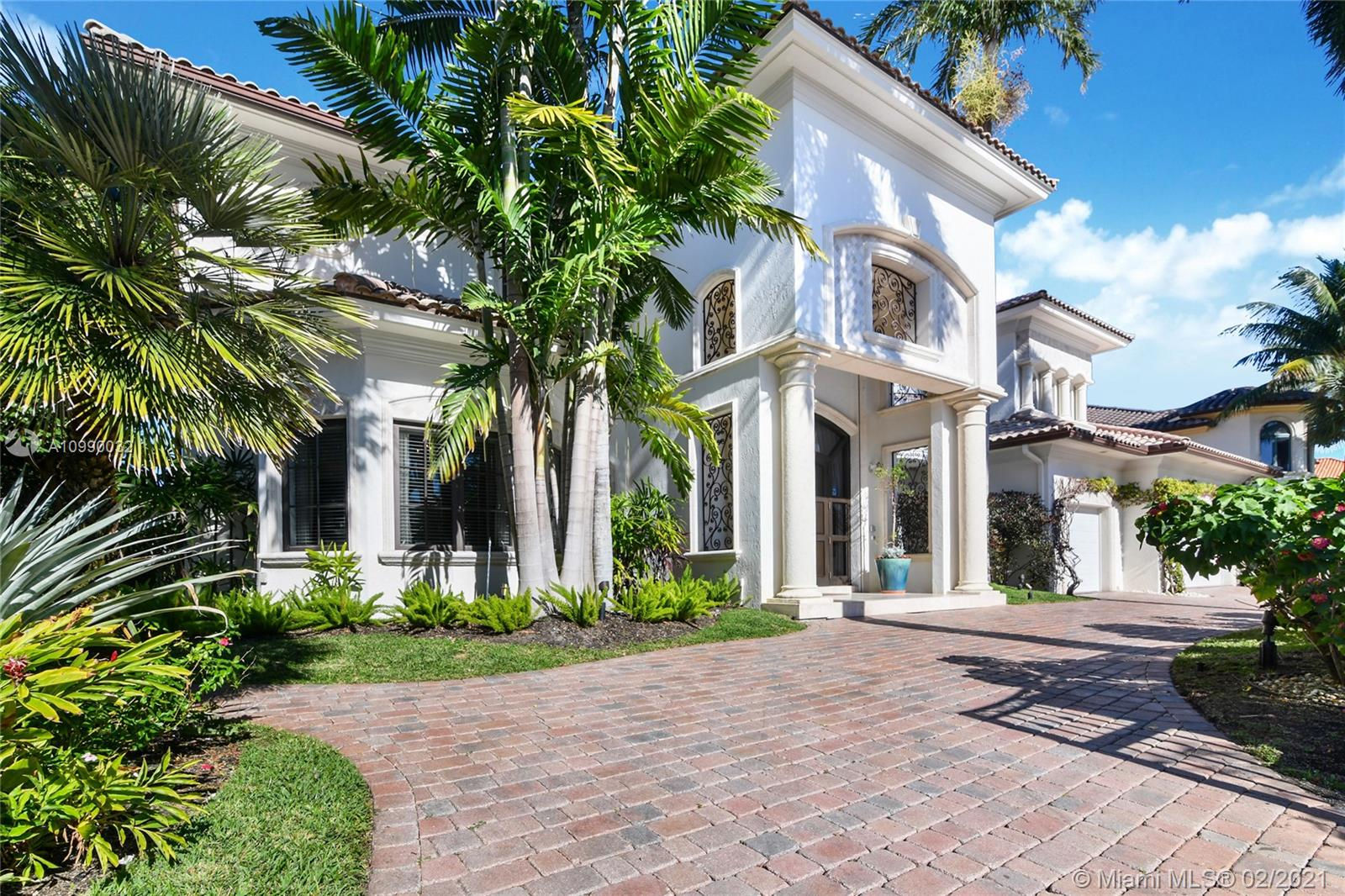 Custom Built Gated Estate within Exclusive Harbor Beach. 120 feet on wide water. Lot's of Indoor and Outdoor