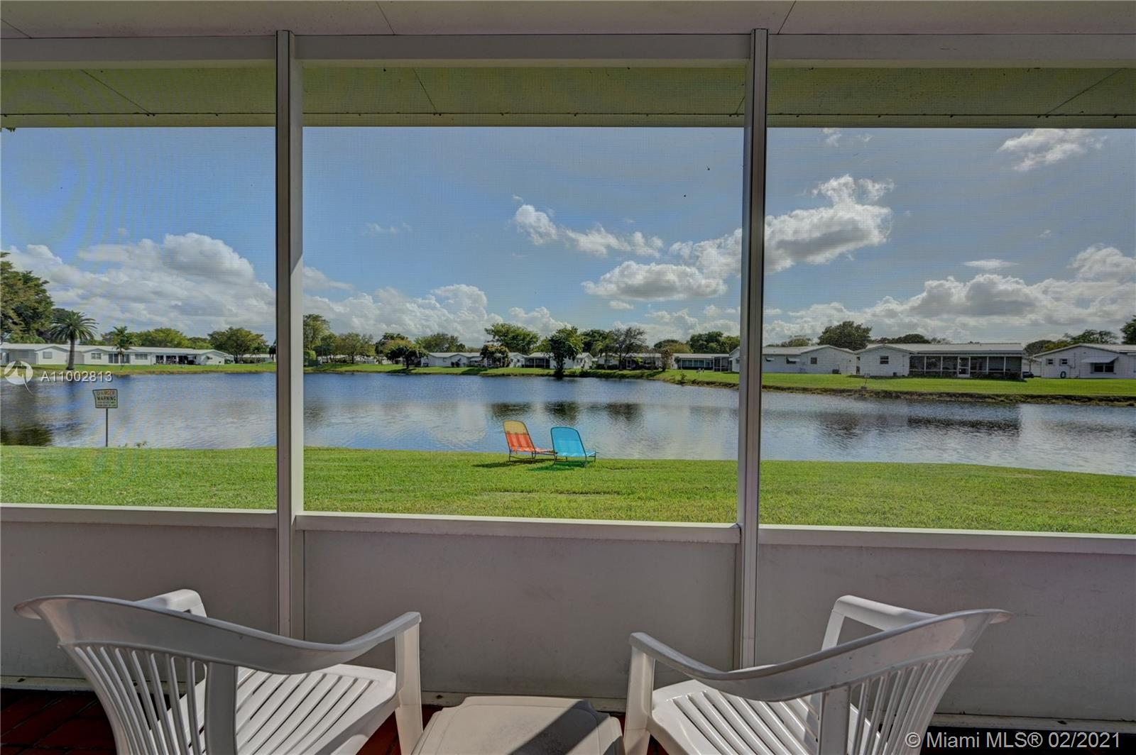 WATER,WATER EVERYWHERE! Breathtaking views & sunsets from this 2 bed 2 bath home! A waterfront gem--one of few directly positioned on wide tranquil lake with highly sought after north/south setting.  Generous 55+ community amenities--2 heated pools & spas, tennis courts, fitness center, clubhouse, free TV/internet, all outside maintenance, free shuttle to stores. Expanded Florida room and screened porch overlooking water with large grilling space. Upgraded LED ceilings with remote controlled fans throughout, extensive security system, walk-in closet, one car garage, doublewide driveway,  hurricane awnings/shutters, newer roof. A/C unit under warranty,  seller funded home warranty through 12/31/21. BEST OF ALL, VAST GRASSY LAKEFRONT ACCESS IS ALL YOURS!
