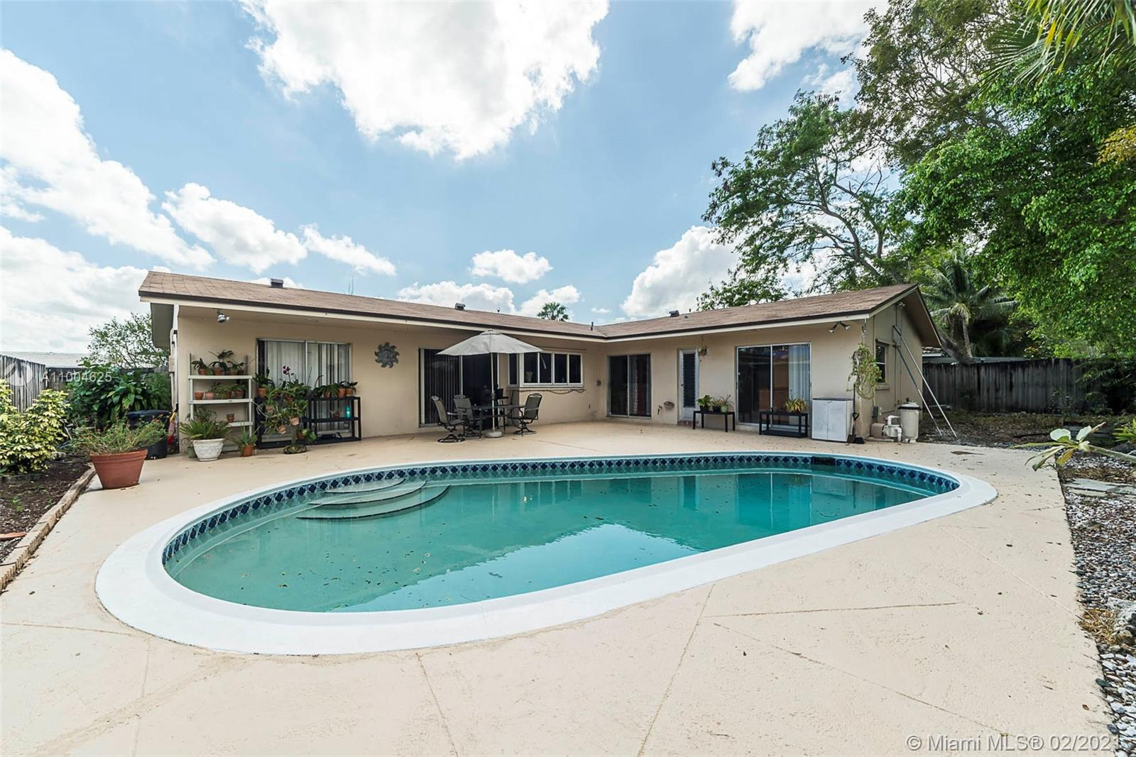 MOVE IN READY! It's a great day to buy a home! This spacious 4/3 Pool home located on a quiet street in Tamarac!  Pool is situated in a spacious gated yard that also features a wonderful pass-through to the kitchen, that is perfect for entertaining.  Tile throughout the main house with updated kitchen and bathrooms. Split floor plan is perfect for your family! The home has an attached 2 car garage and a new roof as of 2018!  Open House Sunday, Feb 28th, 2021
