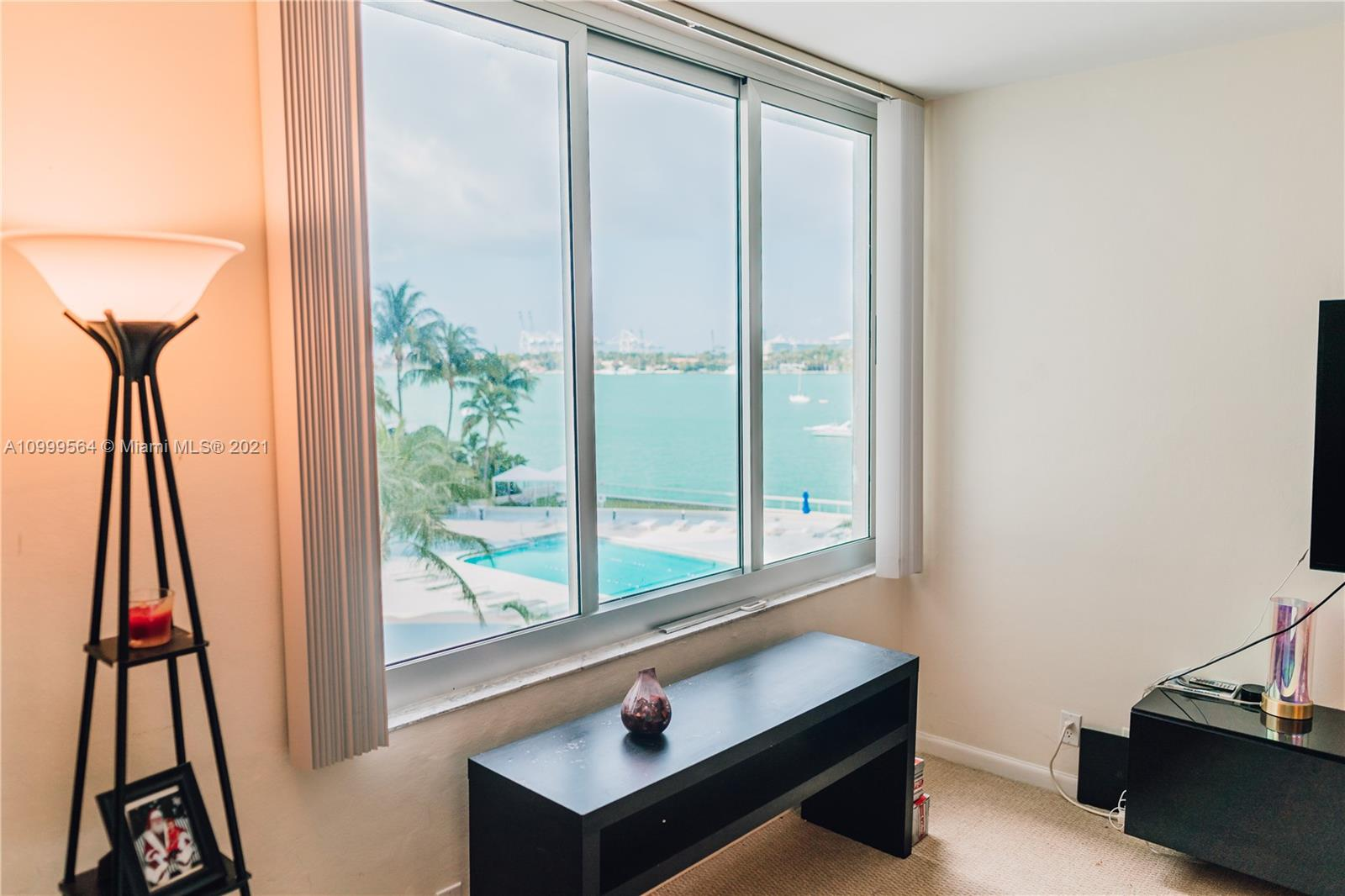 Great location in South Beach! The biggest one bedroom model in the building. 970sf with direct water views. Remodeled kitchen and bathroom. High Impact Windows. Building offers heated pool, BBQ area, gym & gourmet market on site.  Short distance to Whole Foods, Lincoln Road, Trader's Joe; Restaurants, Miami Beach Flamingo Park and the beach!! Pet Friendly Building!