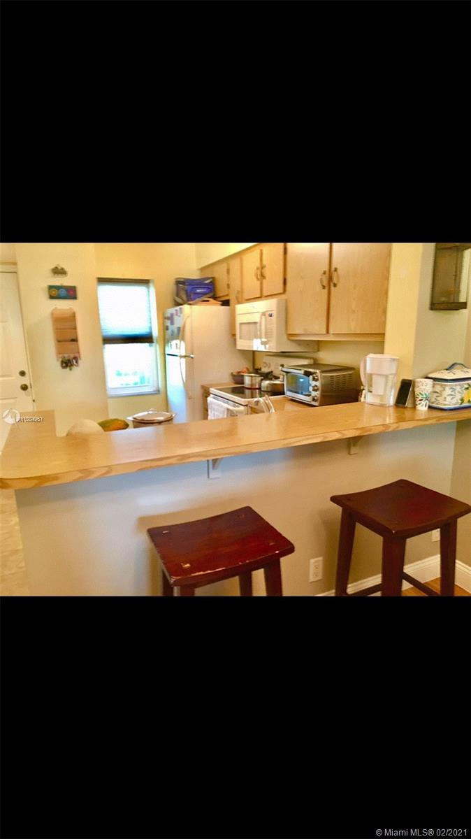 Welcome home to this beautiful 2 bedroom and 2 bathroom unit in Cypress Bend with both lake and pool views.  Many nice upgrades: Renovated Master and Guest bathrooms, brand new AC (Jan 2021) with Nest thermostat, newer water heater (Feb 2019), new microwave, stand alone LG washer/dryer in unit (< 5 years old), impact windows and door, tile and laminate wood flooring throughout.  Up to 2 pets allowed.  Association has lots of amenities: pool, tennis courts, playground, walking/jogging path, gym, library, and much more.  Located close to everything: main highways, restaurants, houses of worship, Tri Rail station, casino and only 6 miles from beaches.