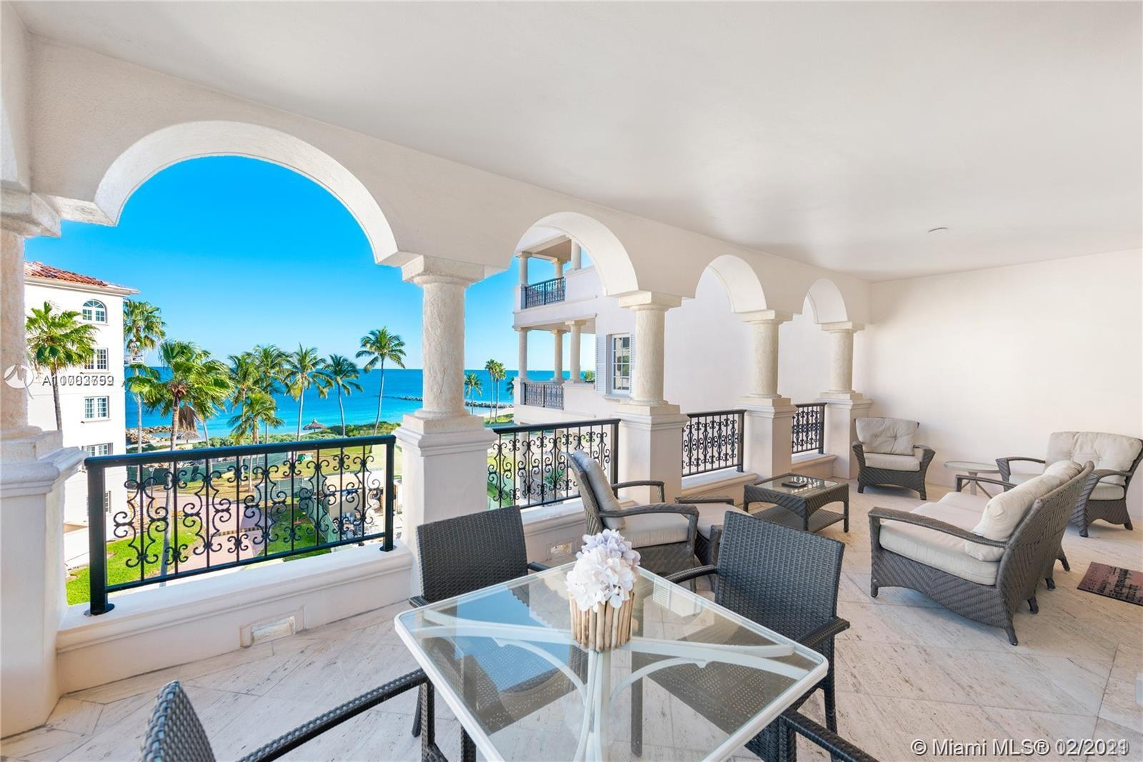 BRIGHT MODERN SEASIDE VILLAGE WITH DIRECT OCEAN AND MIAMI SKYLINE VIEWS. THIS UNIT HAS BEEN COMPLETELY RENOVATED.  FEATURES: 3 BEDROOMS, A LARGE DEN AND 3 BATHS, MARBLE FLOORS, MULTIPLE TERRACES AND A PRIVATE OPEN EXPANSIVE TERRACE OF 550 SQFT WITH GOLF COURSE AND CITY VIEWS.