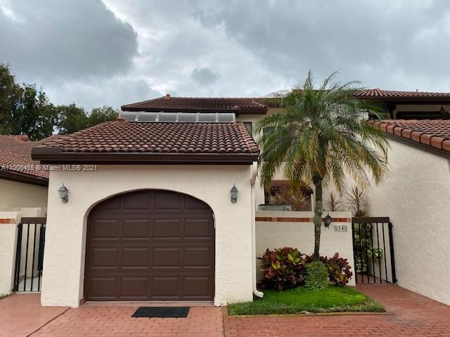 BEAUTIFUL 2 BEDROOMS, 2.5 BATHS, 1 CAR GARAGE AND PRIVATE PATIO TOWNHOME IN THE PRESTIGIOUS DORAL COLONY, FACING THE GOLF COURSE.  SPACIOUS LIVING ROOM AND FORMAL DINING ROOM. REMODELED KITCHEN FOR YOU TO ENJOY. LIVING ROOM HAS AS A FIREPLACE.BOTH BEDROOMS ARE UPSTAIRS, GREAT FOR PRIVACY.  MASTER HAS A WALK-IN CLOSET AND 2 SINKS IN THE MASTER BATHROOM WITH SEPARATE SHOWER AND BATHTUB.  SECOND BEDROOM HAS BATHROOM INSIDE AND A SMALL ENCLOSED BALCONI.  1/2 BATH DOWNSTAIRS FOR GUESTS. 