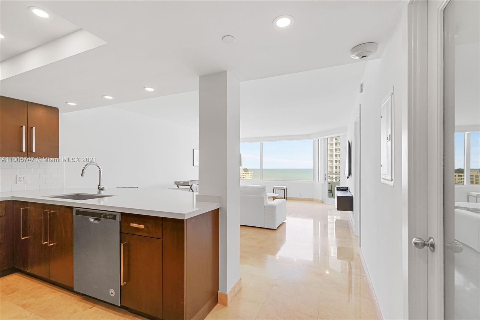 Amazing opportunity. 1 Bedroom Ocean View with Two parking spaces. Renovated with new impact windows and electric shades. Open Kitchen. South of Fifth