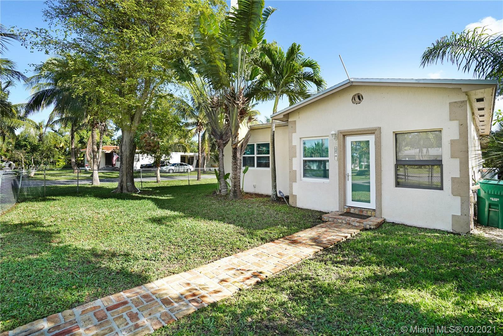 """Come see this beautiful MOVE IN READY Home in the quite, safe and enclosed Neighborhood of Malelueca Gardens! This home is NO HOA fees yet you still have access to private community boat ramp, tennis courts, basketball court, and playground! Equipped with modern updates, wood floors, updated Kitchen, nice sized rooms and closets and office space too. HUGE CORNER LOT, plenty of Parking space, for cars, boats, trailers etc. INVITE YOUR FRIENDS OVER AGAIN, with the outdoor screened in patio area you can socially distance and be """"outdoors"""" at the same time! THIS WONT LAST LONG!! LOCATION, LOCATION, LOCATION... 2 Mins from the highway, 5 Mins from FLL airport and 10 Mins from the beach.... oh and did I mention you have Impact windows!!  Call Listing agent for showings. Must have Pre-approval."""
