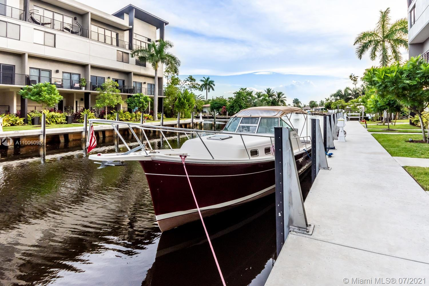 """Bring your boat! Modern Luxurious Upgraded. Waterfront beauty with ocean access is like """"new""""! 3 Bed 3 Baths townhouse with attached garage, on the water, with marina. Open floor plan with high celling's. Ideal full bath and bedroom in first floor! South balconies overlooking the canal. Amenities of a 5-star hotel, with a pool overlooking the marina.  Impressive fixtures, top of the line stainless steel appliances, modern kitchen, and bath cabinetry with Krion countertops, Stylish ceramic throughout the property. Impact windows. Gated security. Children's play area and dog park. Pet friendly with no weight restrictions. 2 more parking spaces in the property plus guest parking always available. Fully equipped gym and clubhouse. Close to US1 and I-95 in Pompano's new development district."""