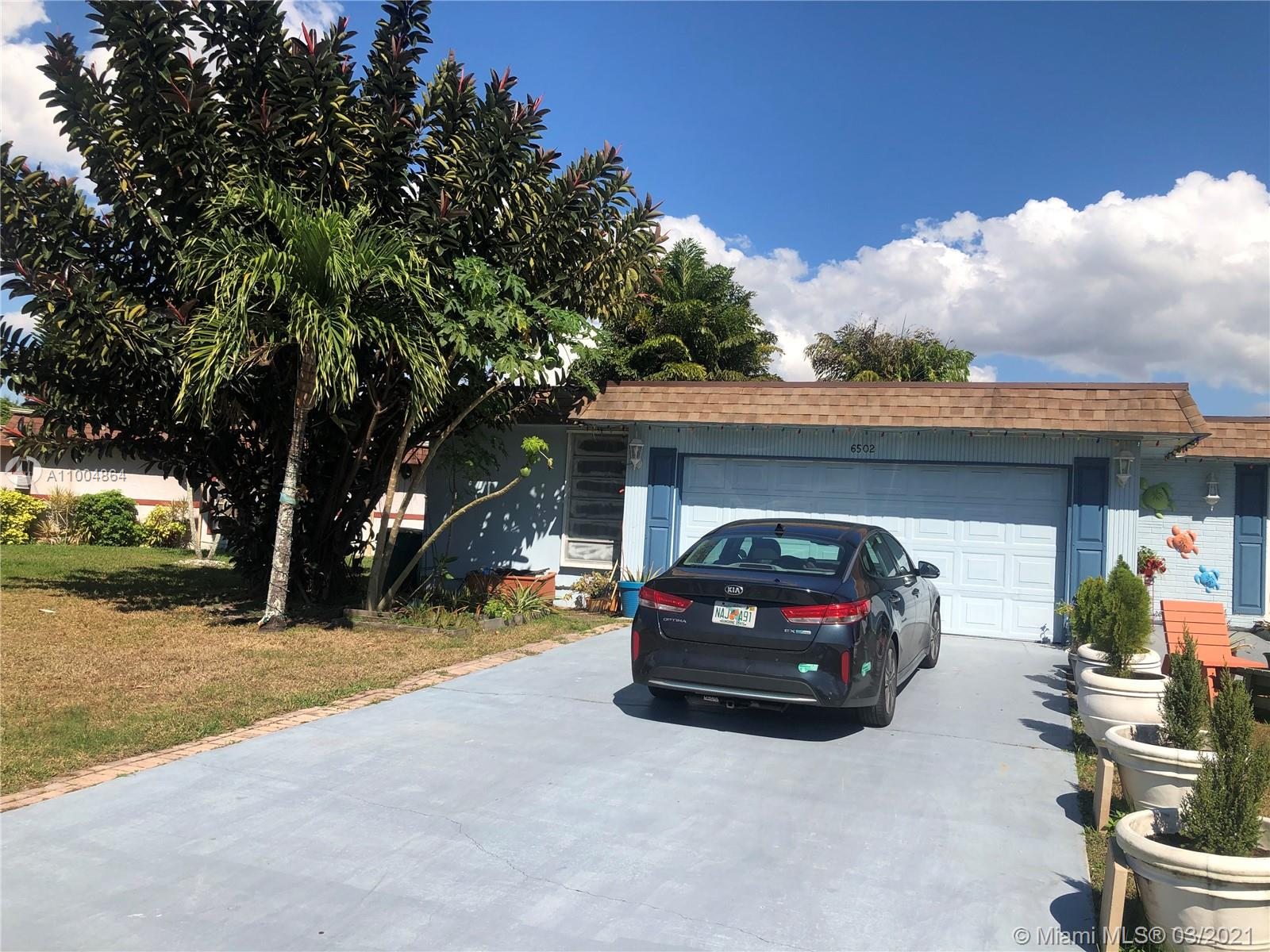 Nice house 2/2 for sale in an all-ages community. Association approval required. spacious living room. Nice kitchen with laundry room. Garage converted in the Third bedroom currently used as a den. Lush tropical backyard with pool and lake. Central ac. Hoa takes care of the lawn.