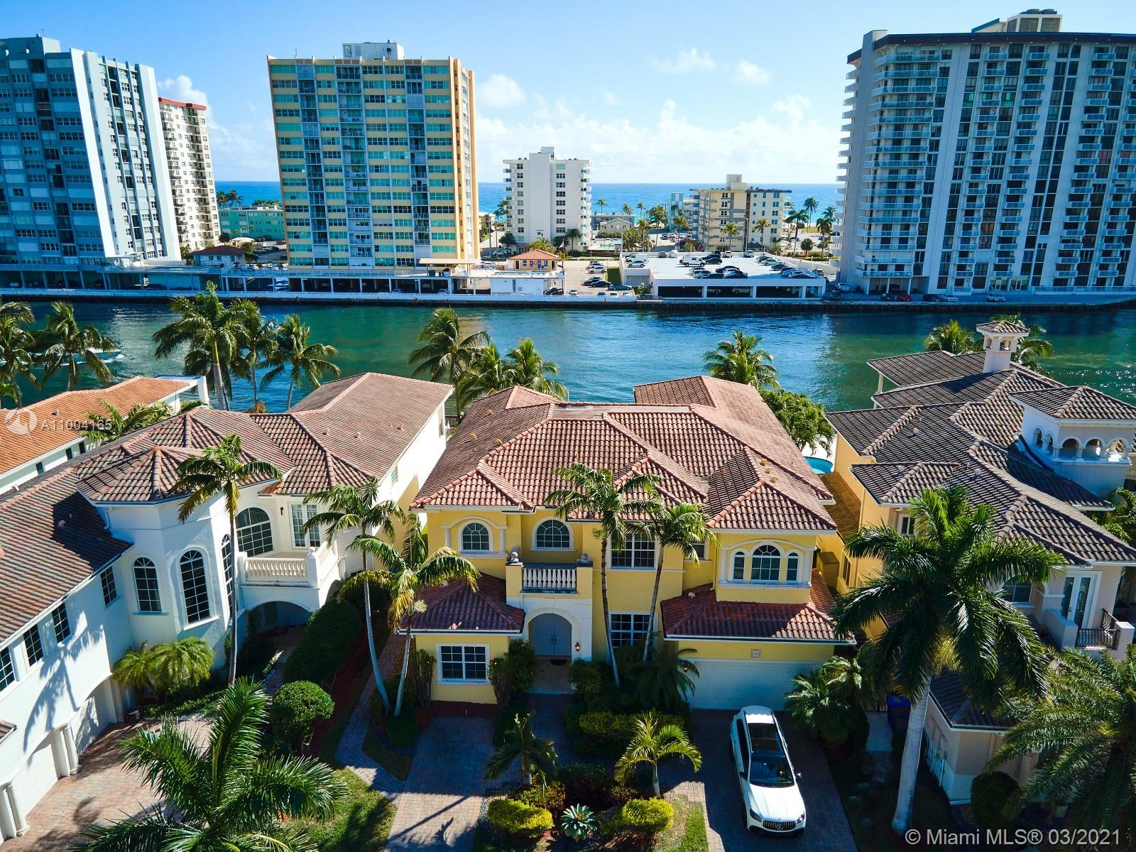Rare Find! Spectacular, luxurious, and highly sought-after Harbor Islands Waterfront estate in exclusive Harbor Islands Private Island Community. This home features 6 Bedrooms and 7.5 Baths, High ceilings 1st and 2nd level, windows in every bedroom, which brings in a lot of natural light to each bedroom. 5529 sq. ft of living space, sits on an oversized lot, with a dock, boat lift, pool plus jacuzzi. Custom luxury walk-in closets in each bedroom. Marble floors throughout and pristine wood floors in each of the bedrooms. Stunning motorized crystal chandelier in the living room. Private guarded community, clubhouse, tennis courts, private park with walking trails, and many other amenities. Please read broker remarks!