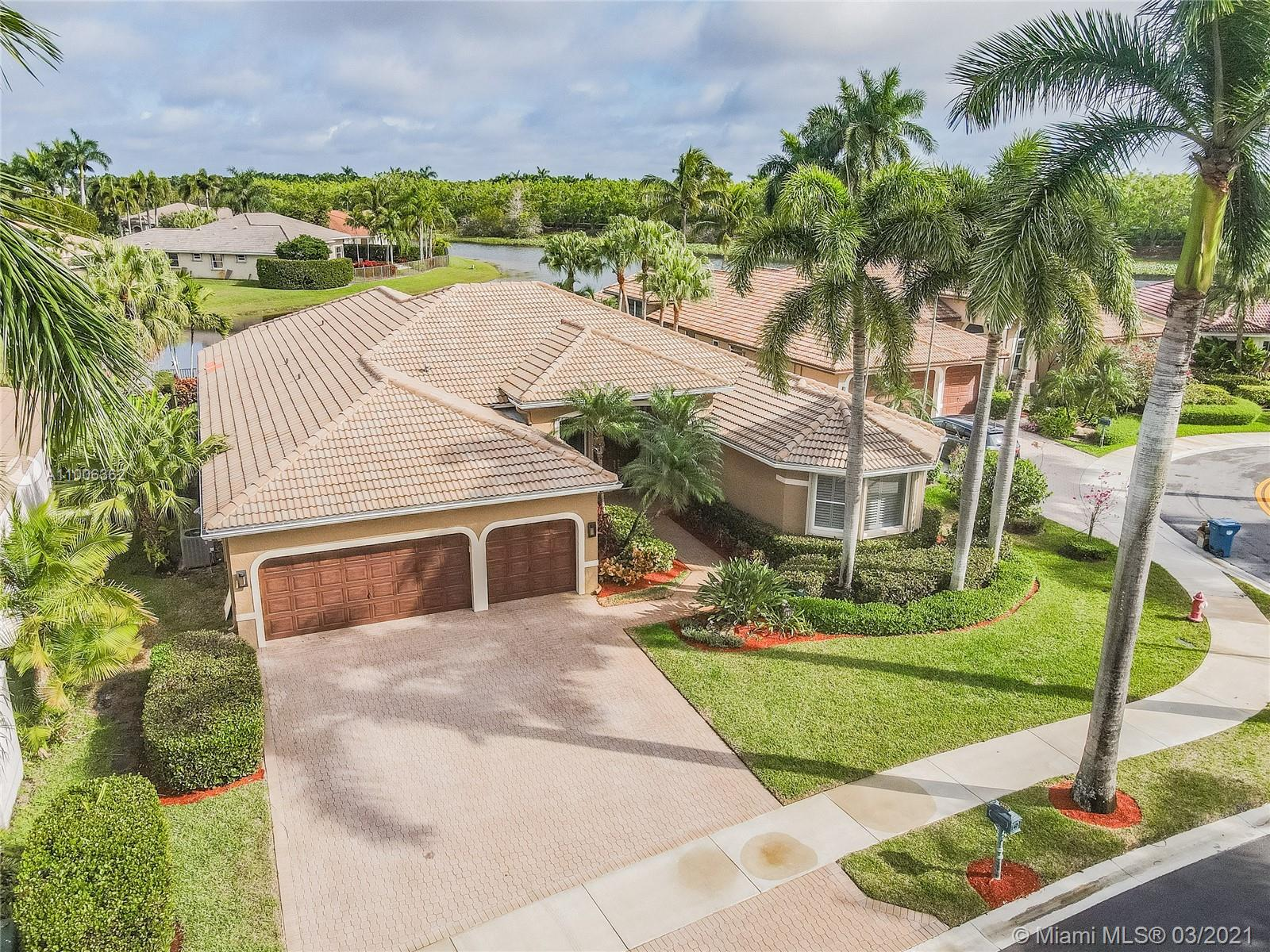 Come see this MAGNIFICENT lakefront-pool home with a 3 car garage in the exclusive prestigious community of Weston Hills, a 24-hour guard gated community. This home features 5 bedrooms, 3 bathrooms, large laundry room, unique master bath with wet room and free standing tub, marble tile, custom walk-in closet, mosquito sprayer in the backyard, beautiful newly renovated pool with diamond brite, tile and pool deck. Renovated kitchen features Stainless steel appliances, cherry wood cabinets, quartz countertops, with an island. Crown molding in the entire house. Accordion shutters throughout. Oversize lot.  2 A/C units recently replaced in 2015. Bring your buyers to the open house March 6, 2021!