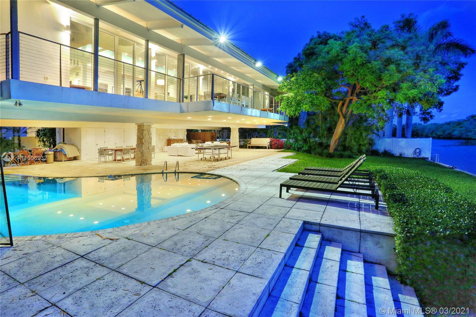 Extraordinary waterfront location. Unique contemporary architecture facing Pines Canal and State Park Bill Baggs. Direct access to Biscayne Bay. The location of this residence is a jewel. Total privacy on a double cul-de-sac street. Gated. Yacht accommodation, large covered pool area to enjoy the water view, cabana bath w/ large inviting couches. The house is elevated w/large Master Suite, reception area, office & open kitchen w/direct water and State Park view. 3 additional bedrooms on the other side of the house. Wood floors t/o the house. High ceilings. Top of the line kitchen, concrete countertop. Reception area offers loft feeling that blends with the exterior. Large balcony. Beautiful landscape and trees.