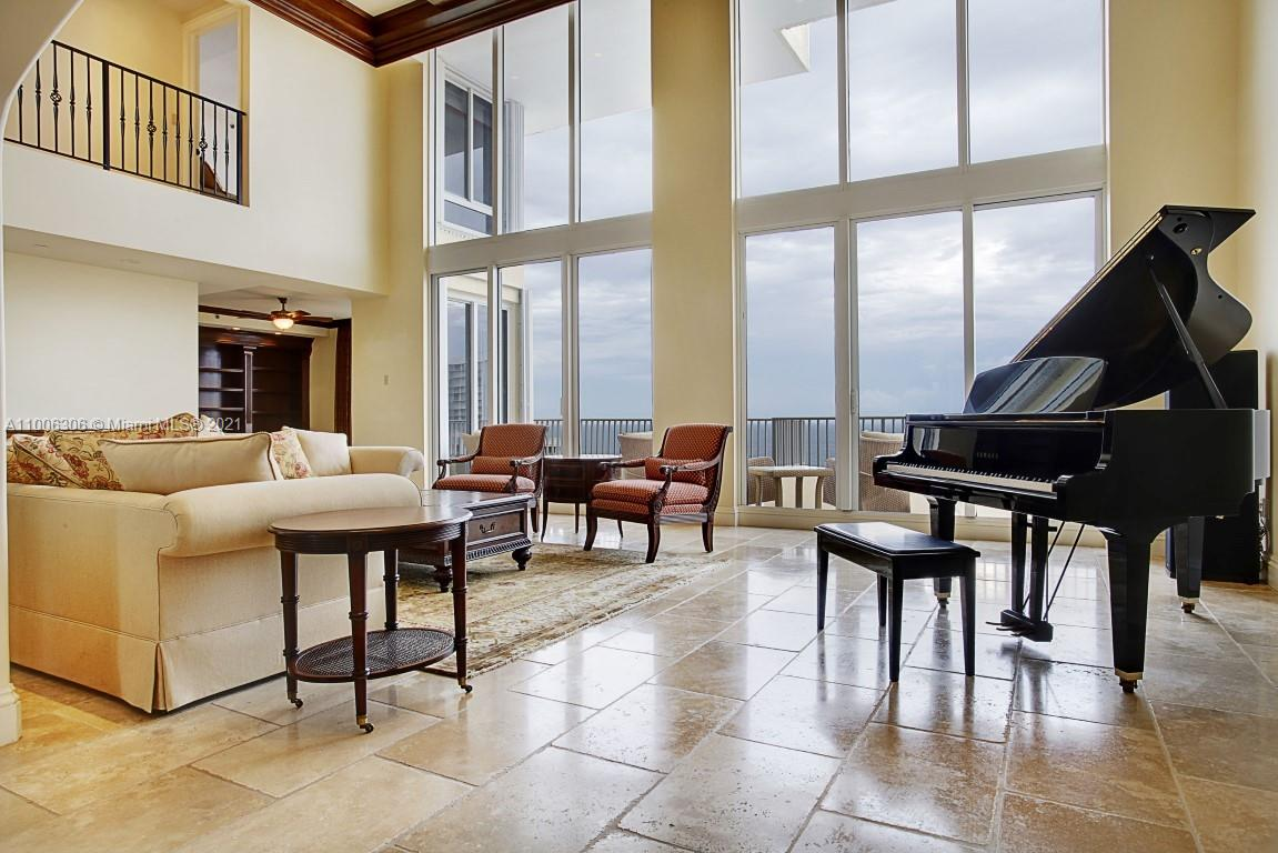 """The premier penthouse in Key Biscayne. For owners who want the feel of a home on top of the highest building at Ocean Club with the best possible Key Biscayne views. Three floor (triplex) with over 5,800 sq ft under air and over 2,600 sq ft of outdoor spaces with spectacular rooftop terrace, 8,400+ sq ft total. Flow through ocean & bay views with three-floor grand circular staircase. Configured as a 5 bedroom, 6.5 bath with open office, detached media room with full bath. Private steam room, sauna, and rooftop terrace with hot tub. One of two units in Club Towers or Ocean Towers with full double floor combined double height floor plan. This penthouse consists of three complete combined -01 line floor areas. Includes Ocean Club Club Tower II """"Hobby Room"""" with full bath. 4 parking spaces"""