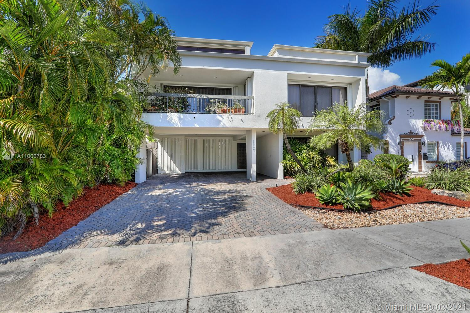 Unique, contemporary two-story home in a quiet & secure North Coconut Grove neighborhood. Walk or bike to bayfront parks, marinas & the Grove village's galleries, boutiques & cafes. Light-filled living room features double-height, wood-beamed ceilings & expansive wall space for displaying art collections. Recent professional designer renovations include: custom kitchen with Bosch & built-in Sub-Zero appliances + striking backlit-blown glass backsplash. Additional renovations include: custom elevator, custom lighting, 2 new HVAC systems, all electrical & plumbing and new bathrooms with custom-designed frosted glass windows, marble countertops & custom cabinetry. Oversized, ultra-private courtyard pool centers the outdoor living area. Minutes to downtown, MIA, Key Biscayne & the Beaches.