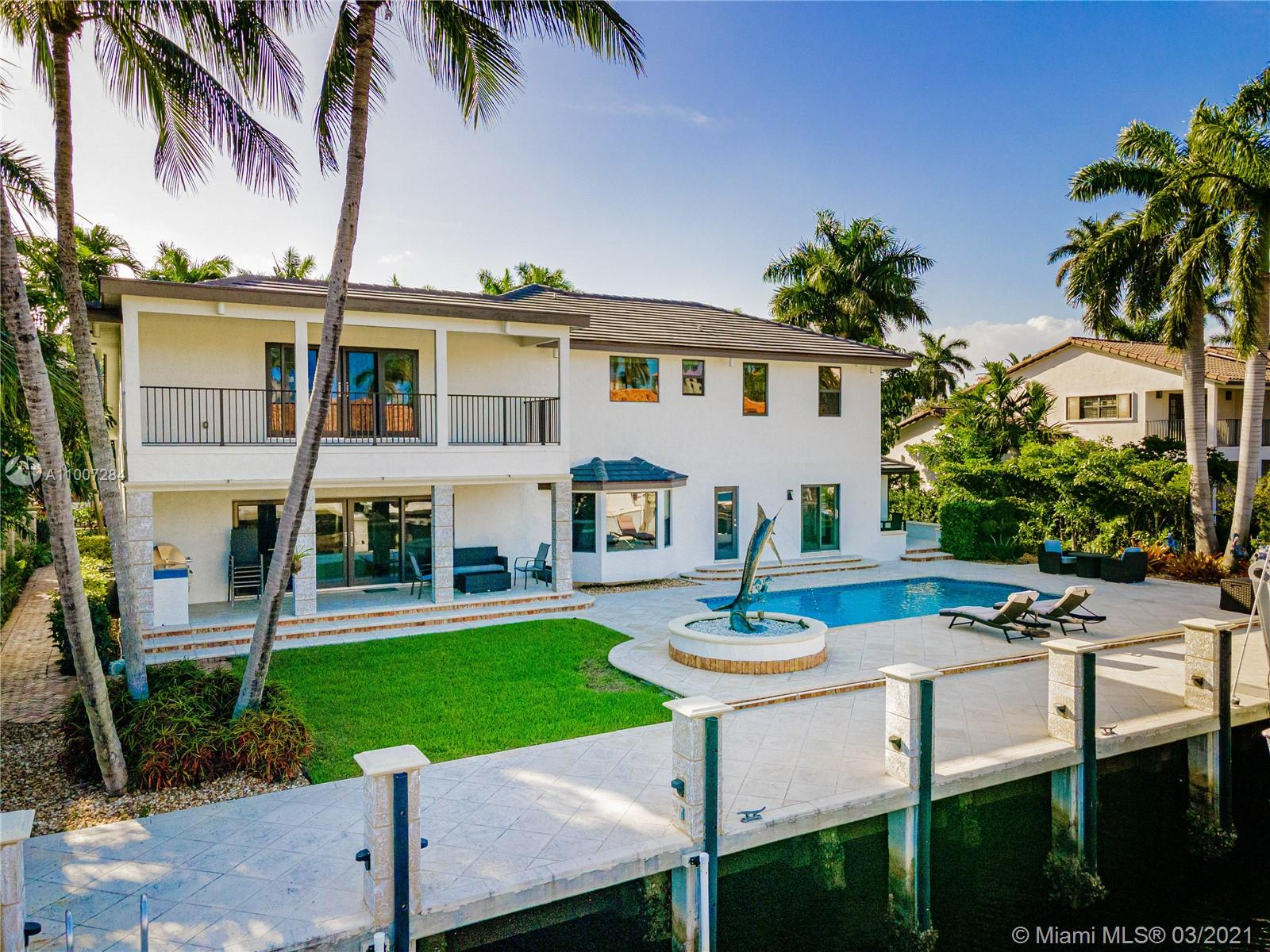 Gorgeous waterfront property with 100 ft private dock and boat lift. Close to intracoastal water, and ocean access. This 5-bedroom home has a full bathroom in every room, and 1 half bath downstairs. Master suite is upstairs with exquisite bathroom with large walk in shower and deep bathtub, both overlooks the water. Master suite also features private patio overlooking the water. Kitchen completely remodeled with new cabinets, deep sink, kitchen island, and quartz countertops. House also features impact windows throughout property. Backyard features a heated pool, covered patio with outdoor BBQ, and faces the east. 3 car garage with ample parking in front driveway. Private walkway to entrance to the front of the home.