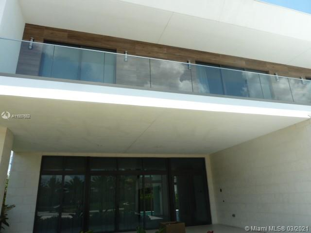 $180.000.00 in UPGRADES GREAT OPPORTUNITY, UNDER PRICED FOR A QUICK SALE. PALATIAL ESTATE 5 BEDROOS 6.5 BATHS IN AWARDWINNING BOTANIKO!, THIS HOME AFFORDS THE ULTIMATE IN PRIVACY, SECURITY AND ENJOYMENT. SPORTING AN ABSOLUTELY IMPRESSIVE FLOORPLAN AND EVERY UPGRADE AVAILABLE, THE WIDE OPEN KITCHEN & DINING ROOM FLOWS DIRECTLY OUT TO THE SPRARKLING POOL DECK & SUMMER KITCHEN.THE AMPLE LIVING AND FAMILY ROOMS PROVIDE .UPGRADES ABOUND AND INCLUDE THE PRIVATE MEDIA ROOM, EXPANSIVE MASTER SUITE FULLY INTEGRATED SMART HOUSE TECHNOLOGY, CALACATA COUNTERTOPS, IMPORTED WALNUT CABINETRY & BRAZILIN WHISPER PINE FLOORS THROUGHOUT. 46 EXTRA HIGH HAT LIGHTS, HOUSE PREWIRED WITH AUDIO GOLD PACKAGE, ,ELECTRIC SHADES, STAFF QUARTERS, IT WON'T LAST  AT THIS MAIZING PRICE