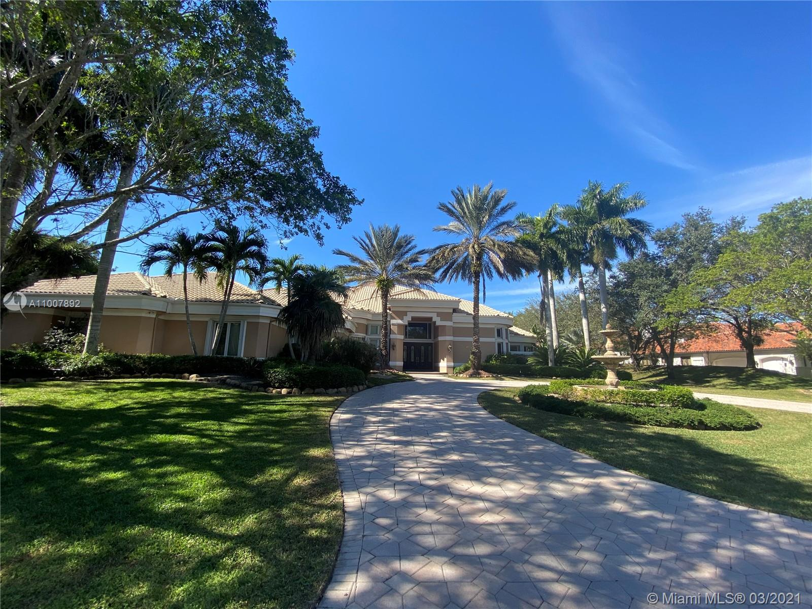 Gorgeous One Story Home at The Exclusive Gated Community Windmill Ranch Estates. One of the Best Waterfront Properties. Spectaculars Sunsets. Great Layout, Tall Ceilings w Glass Doors and Windows overlooking the Pool and Lake. 6BED/6BATH, Office, Laundry Room, Wet Bar, Marble and Hard Wood Floors, Gourmet kitchen, Stainless Steel Appliances, Viking Gas Range, Two Electric Ovens, Food Warmer Drawer, Sub Zero Refrigerator, Ice maker, Storm Impact French Doors, Accordion Shutters, 3 Car Garage, 4 A/C, Spacious Master Bedroom with two walking closets, Electric Shades . Fully fenced Lot. Covered patio excellent for entertainment. Municipal Sewer.