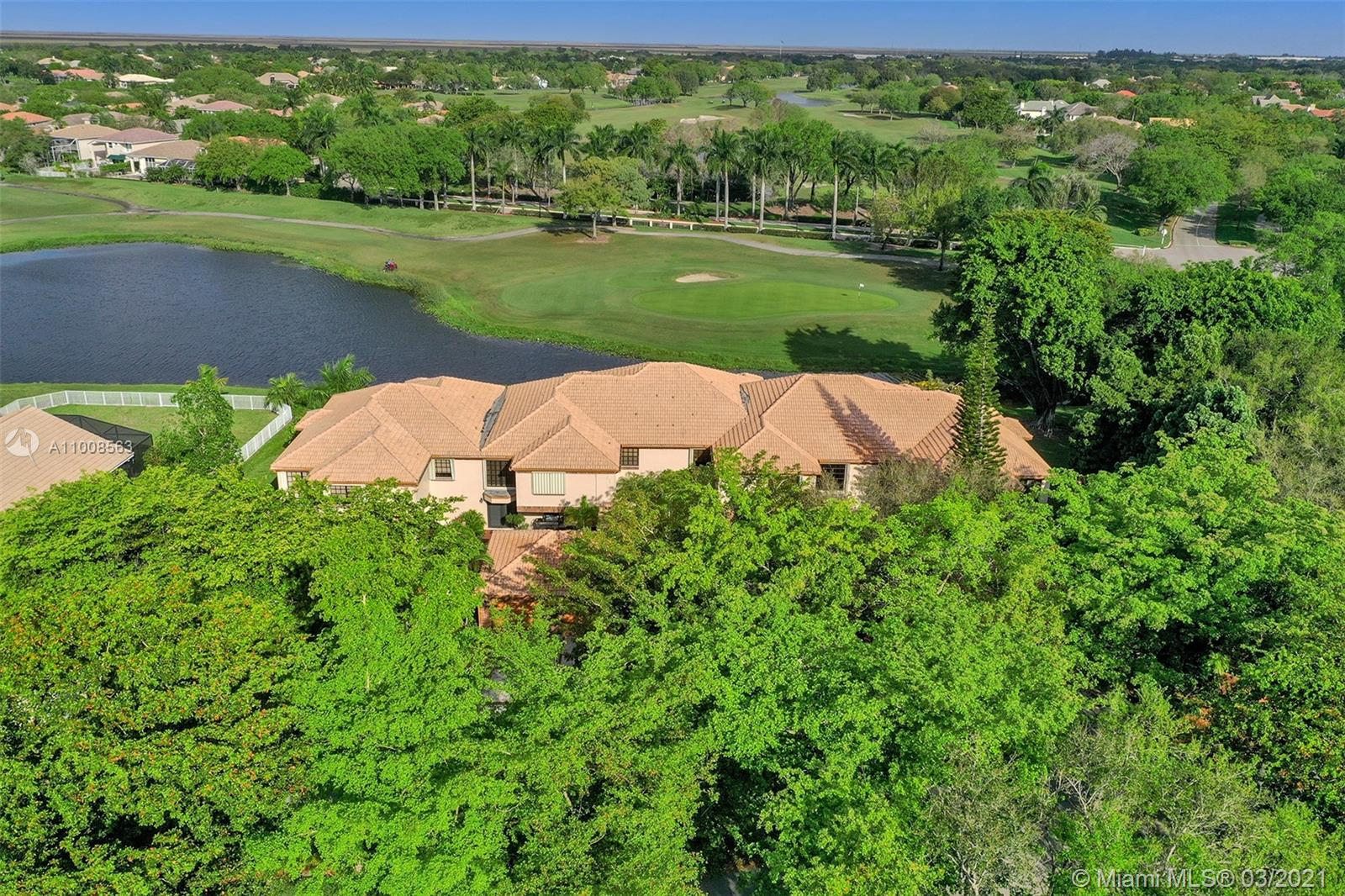 WOW! GREAT BUY ON THIS RARELY AVAILABLE VILLA COACH HOME WITH A ONE CAR GARAGE AND INCREDIBLE WATER AND GOLF VIEWS IN WONDERFUL EAGLE TRACE COMMUNITY! UPDATED KITCHEN & BATHS! BRAND NEW A/C! ACCORDION SHUTTERS! NEAT, CLEAN, AND READY TO GO!